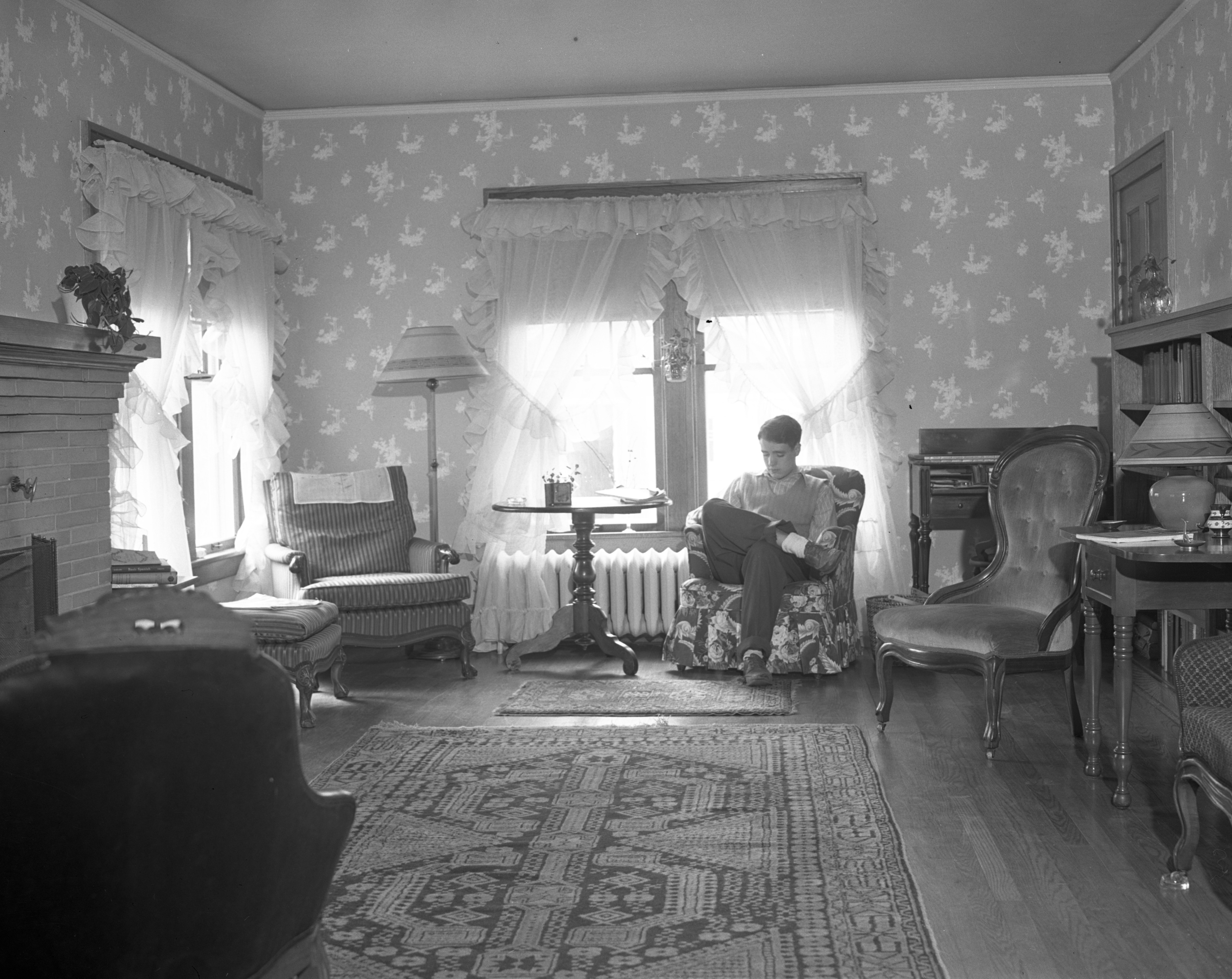 Russell Baker (of Bobby and the Old Professor) sitting in living room, 1941 image