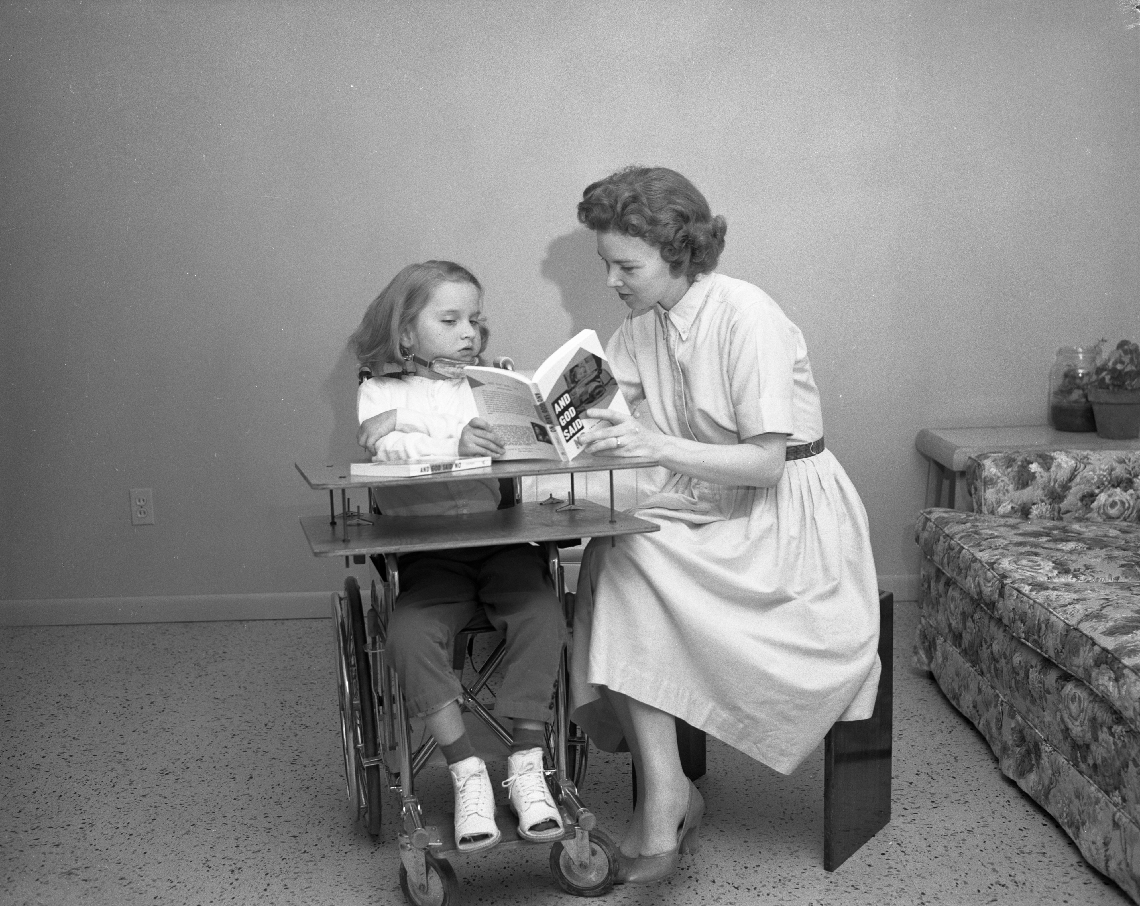 "Lael Cappaert reads her book to daughter Andrea (""Andy""), May 1961 image"