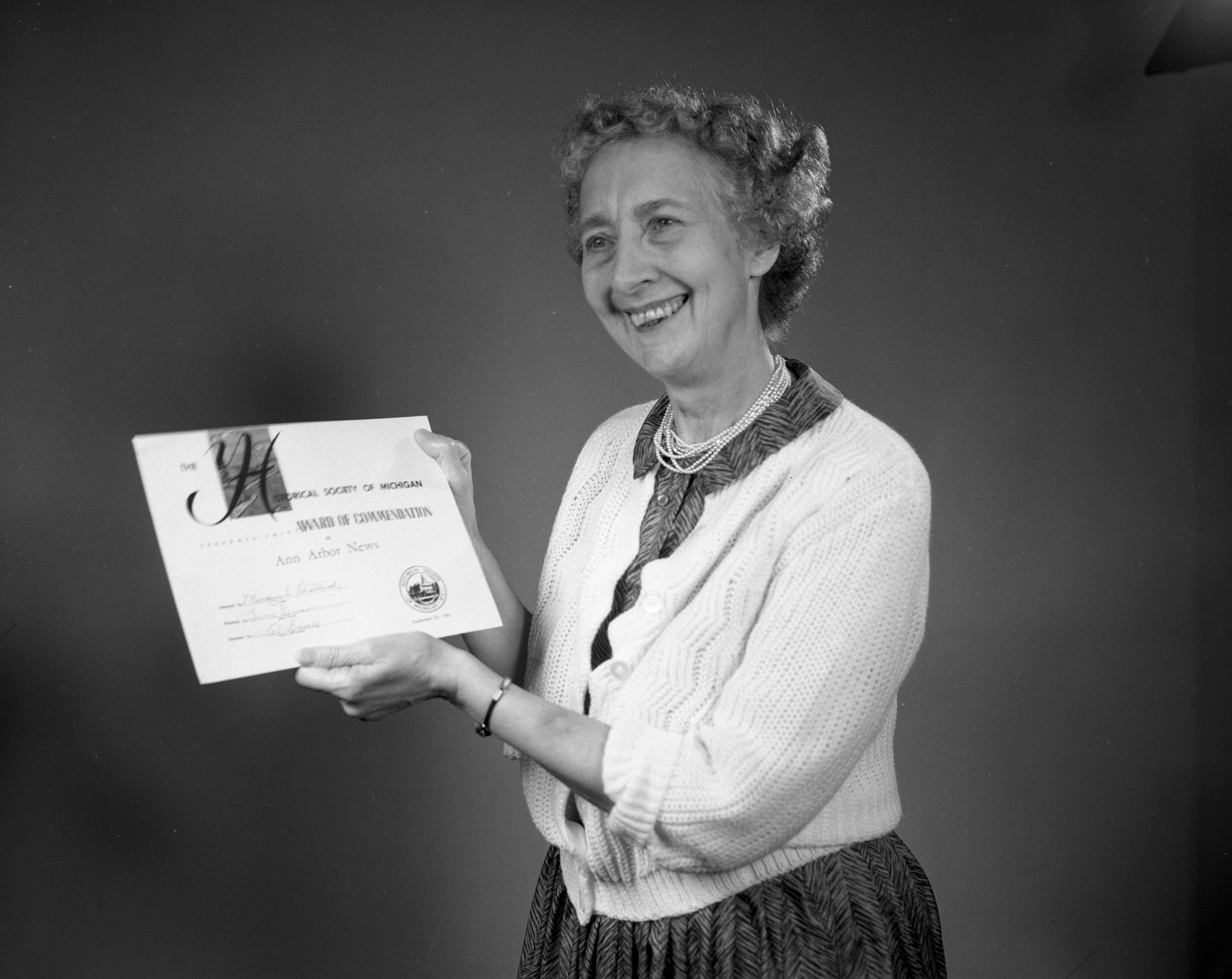 Local Historian Lela Duff All Smiles After Winning Historical Society of Michigan Award For Ann Arbor Yesterdays Series, September 1961 image