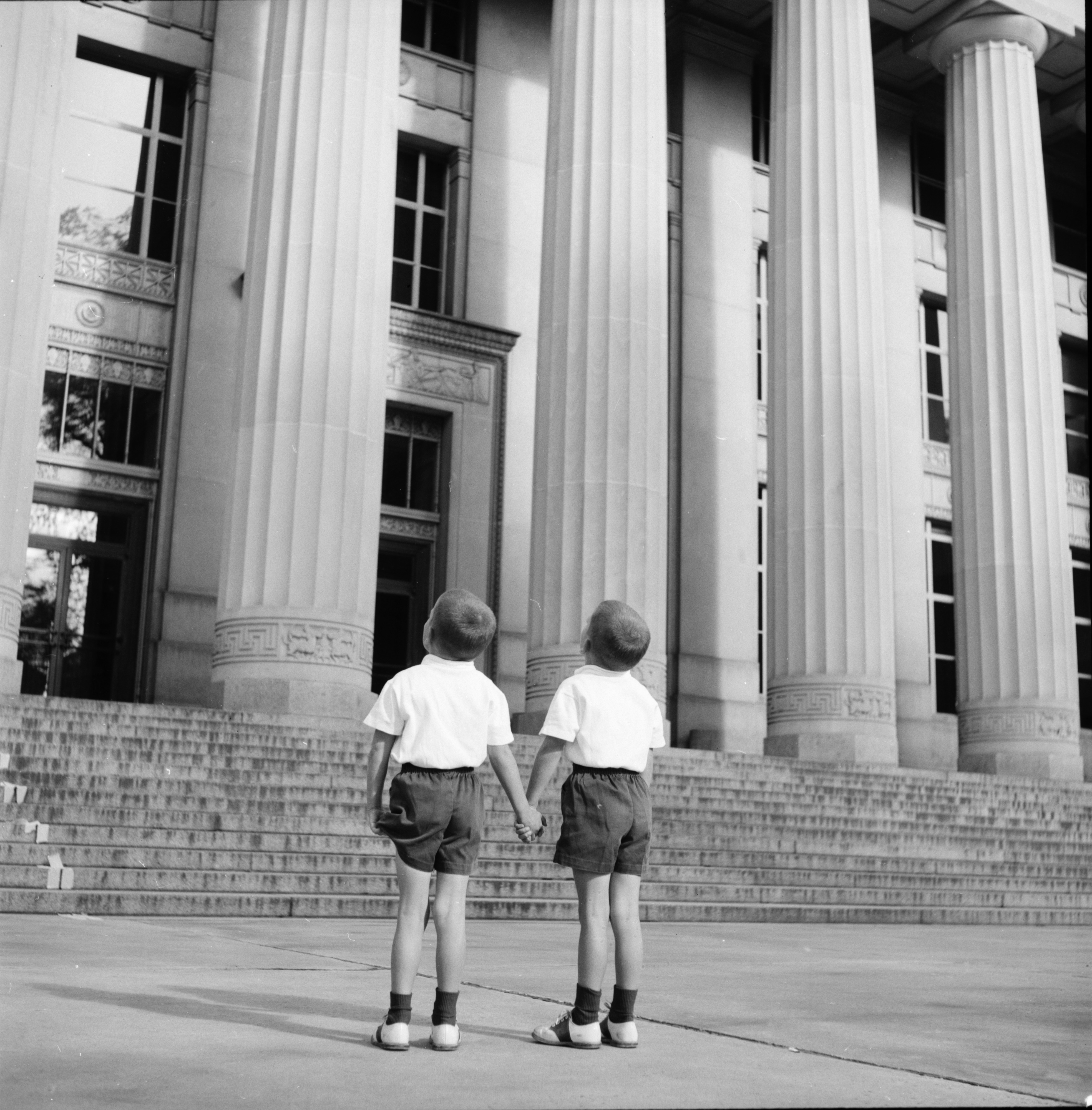 Emmons twins in front of Angell Hall, for Ann Arbor Trust ad, September 1957 image