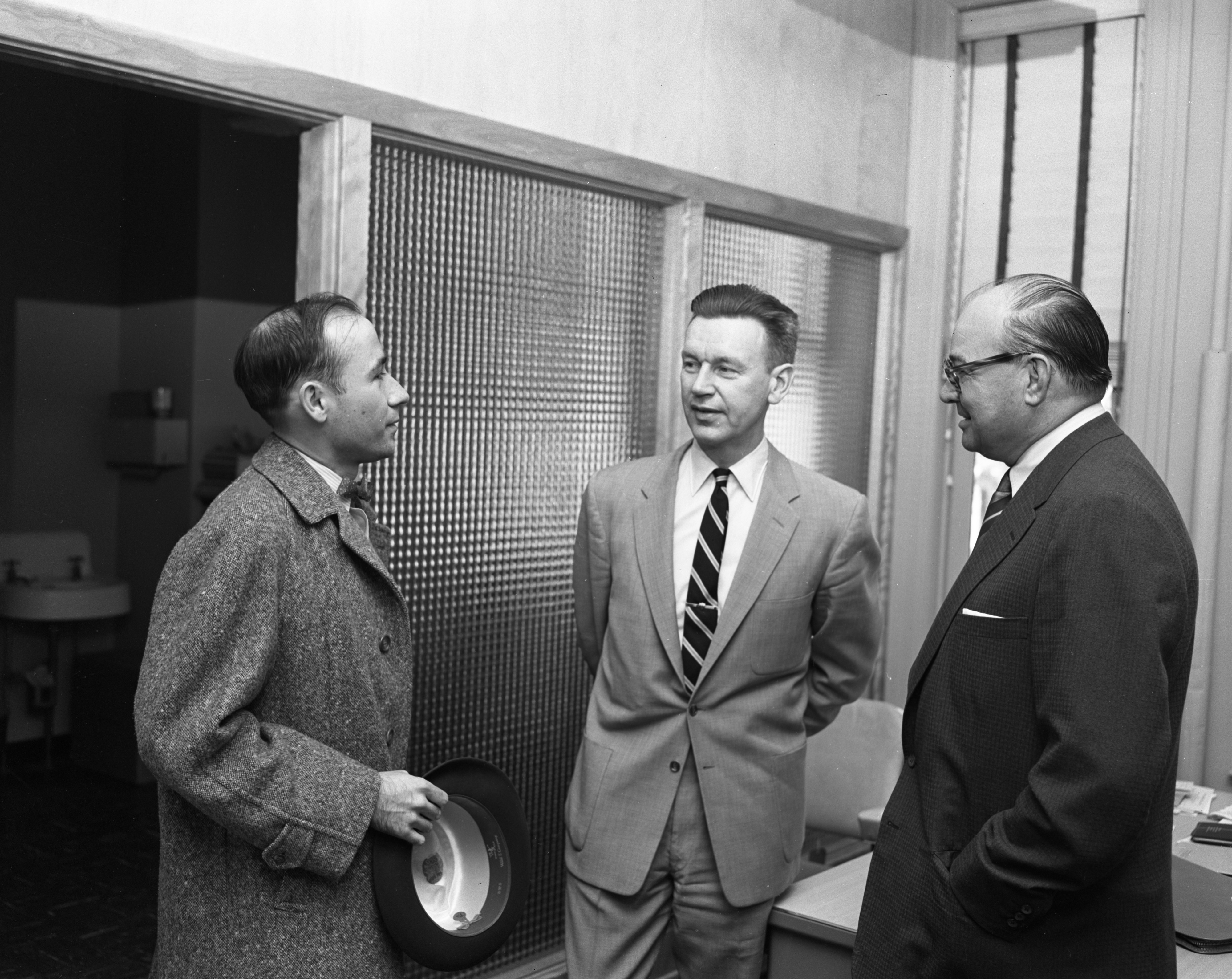Guy C. Larcom, Jr., Ann Arbor's new city administrator, meets with George Sallade and Mayor William E. Brown, April 1956 image