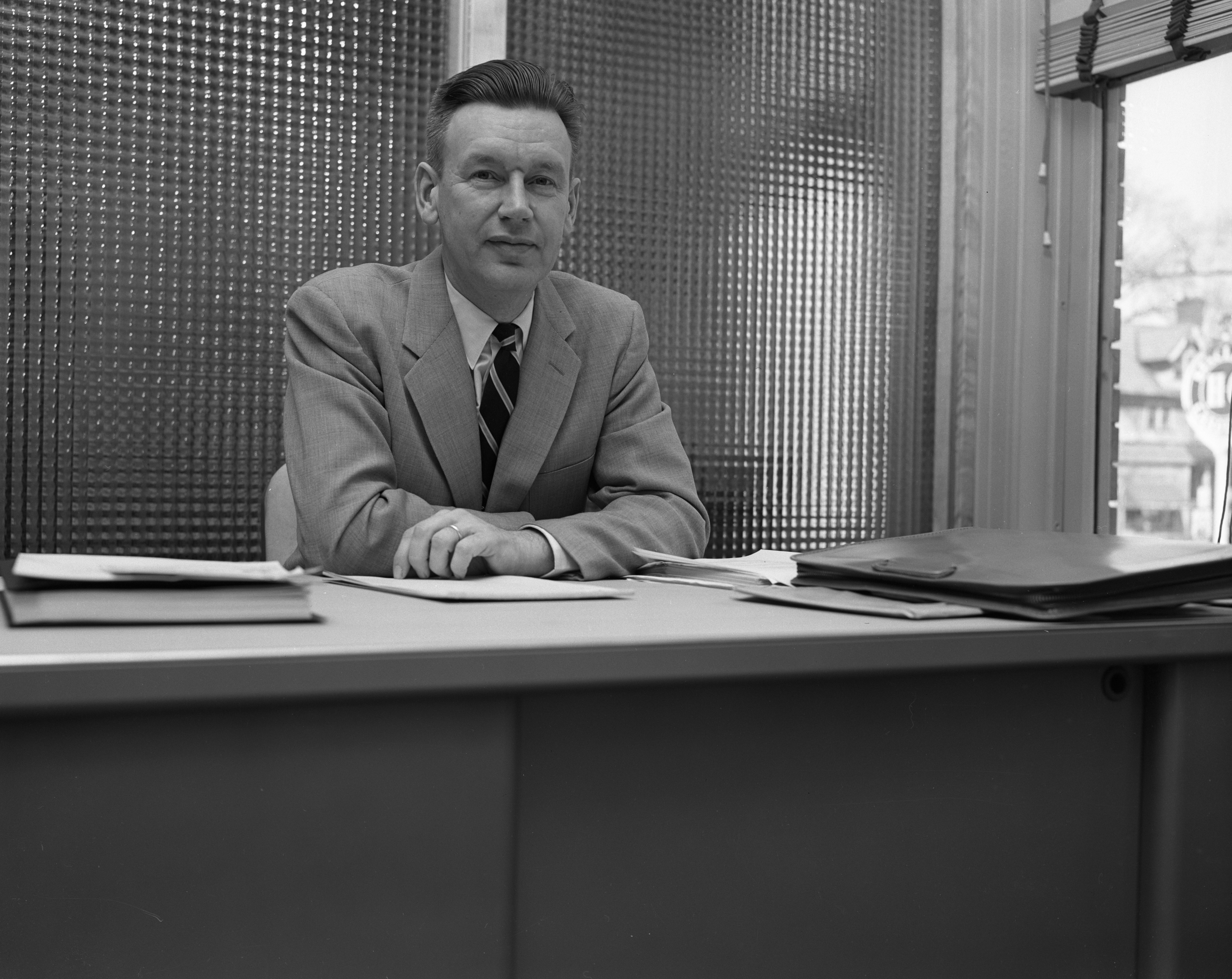 Guy C. Larcom, Jr., at his desk on the first day as Ann Arbor's new city administrator, April 1956 image