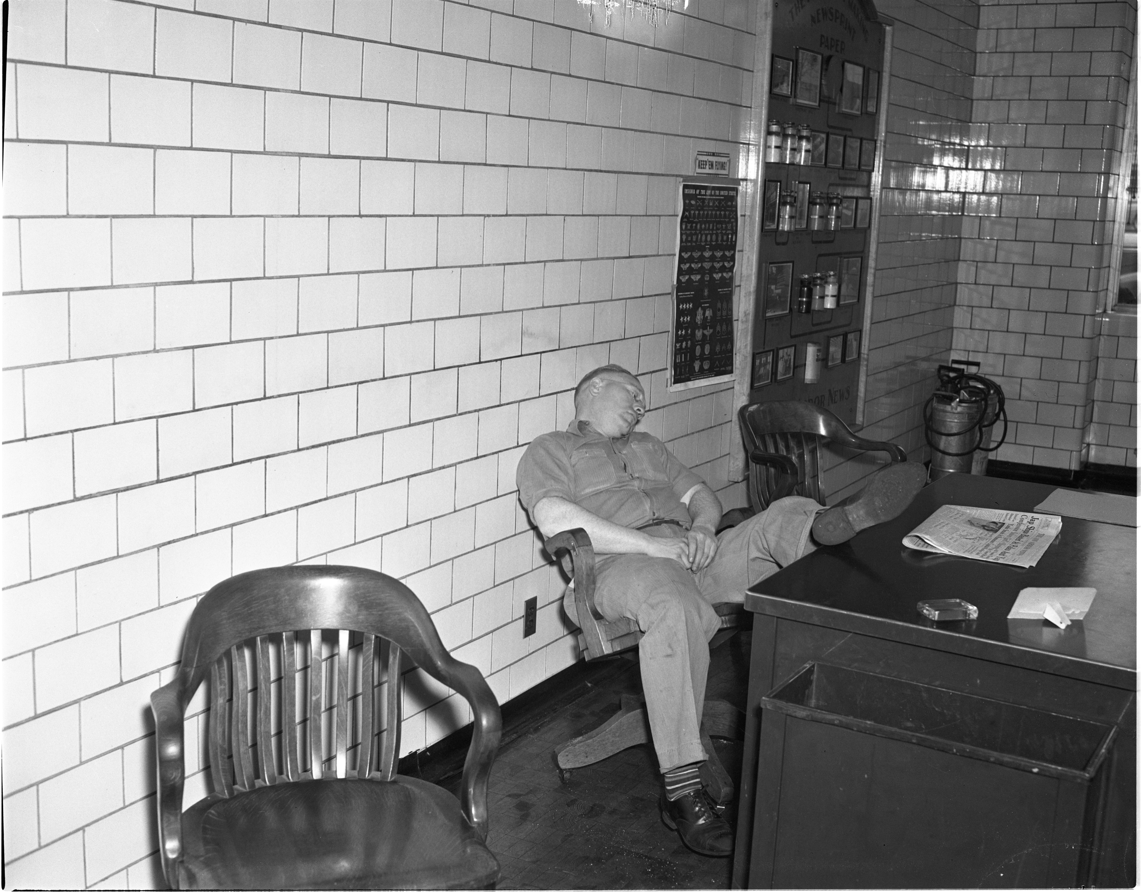 Red Losey Asleep At The Ann Arbor News, April 1944 image