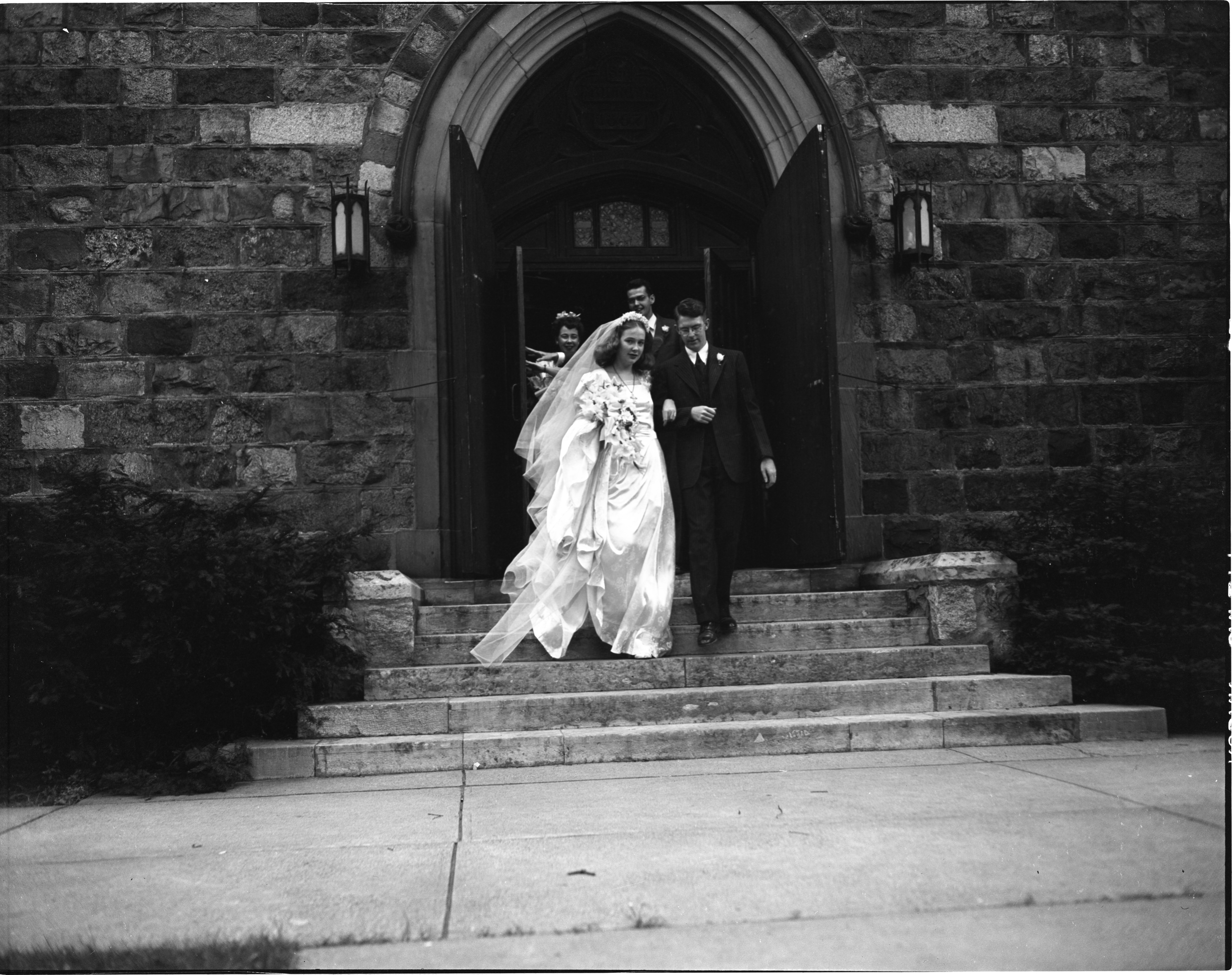 Mr. & Mrs. A. Worth Mallory Leave St. Andrew's After Their Wedding - August 30, 1946 image