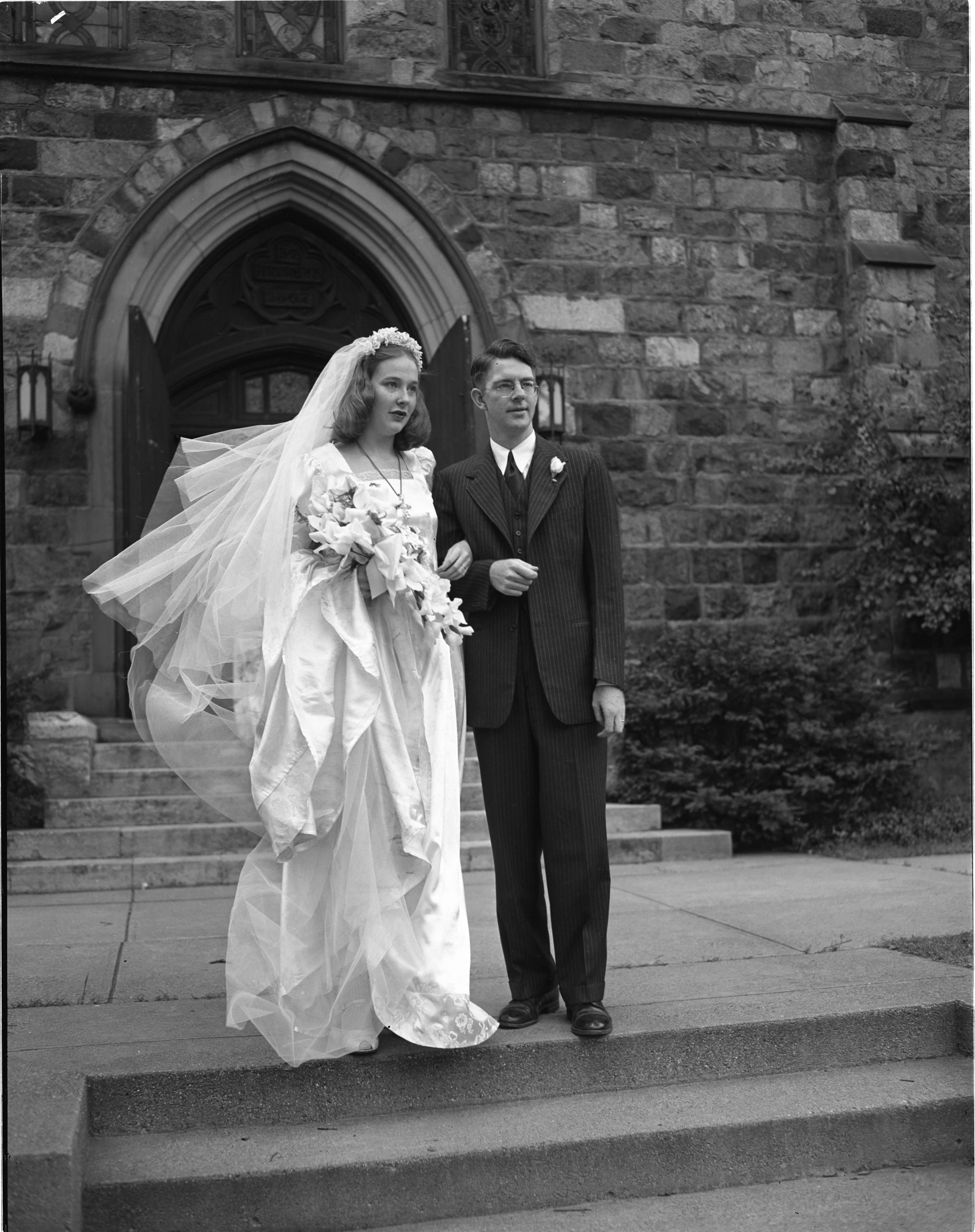 Mr. & Mrs. A. Worth Mallory Outside St. Andrew's After Their Wedding - August 30, 1946 image