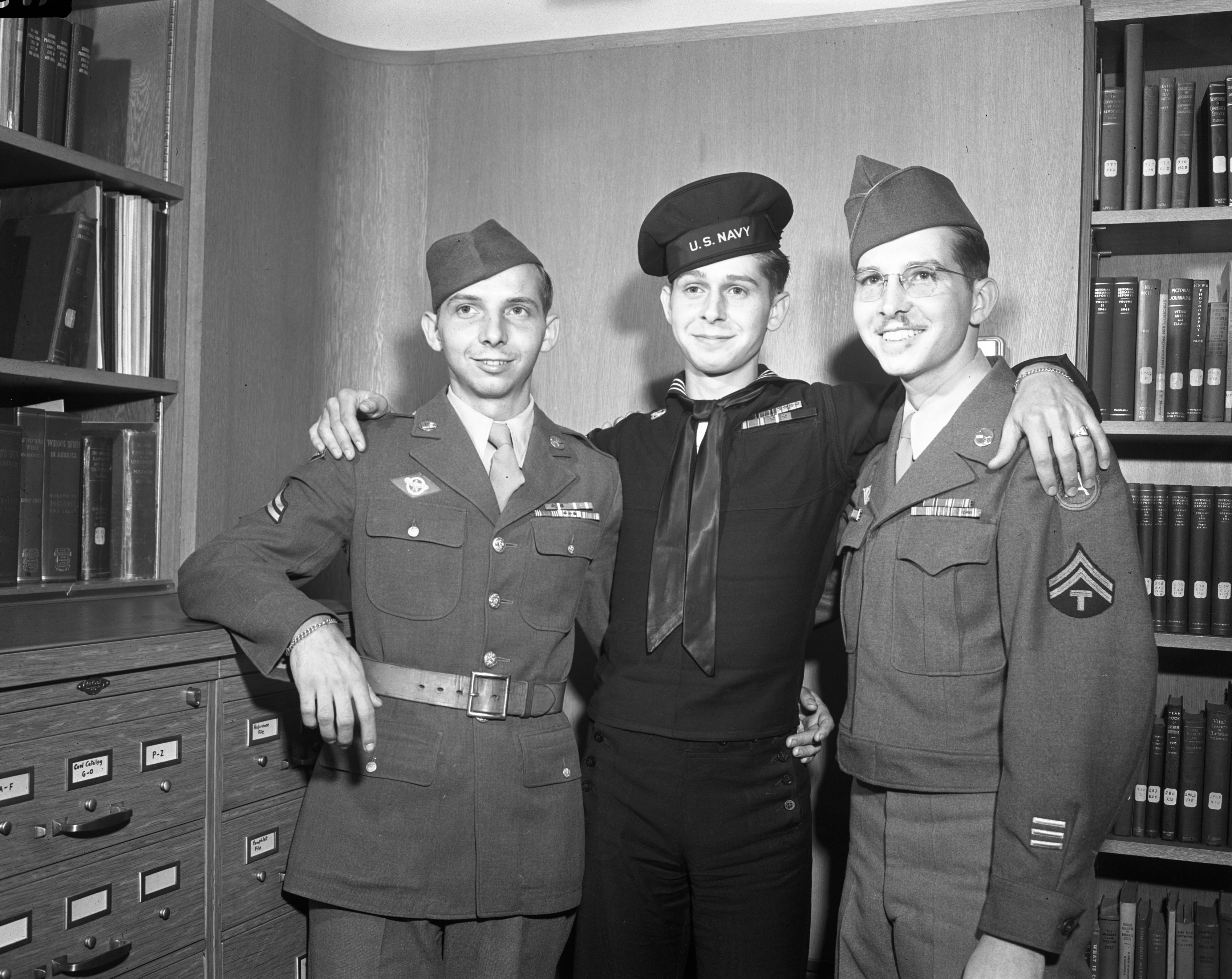 "The Rafeld Brothers: (l to r) Junius ""Lefty,"" Herman ""Peanuts,"" and Clarence ""Jeep"" Jr., all veterans, January 1946 image"