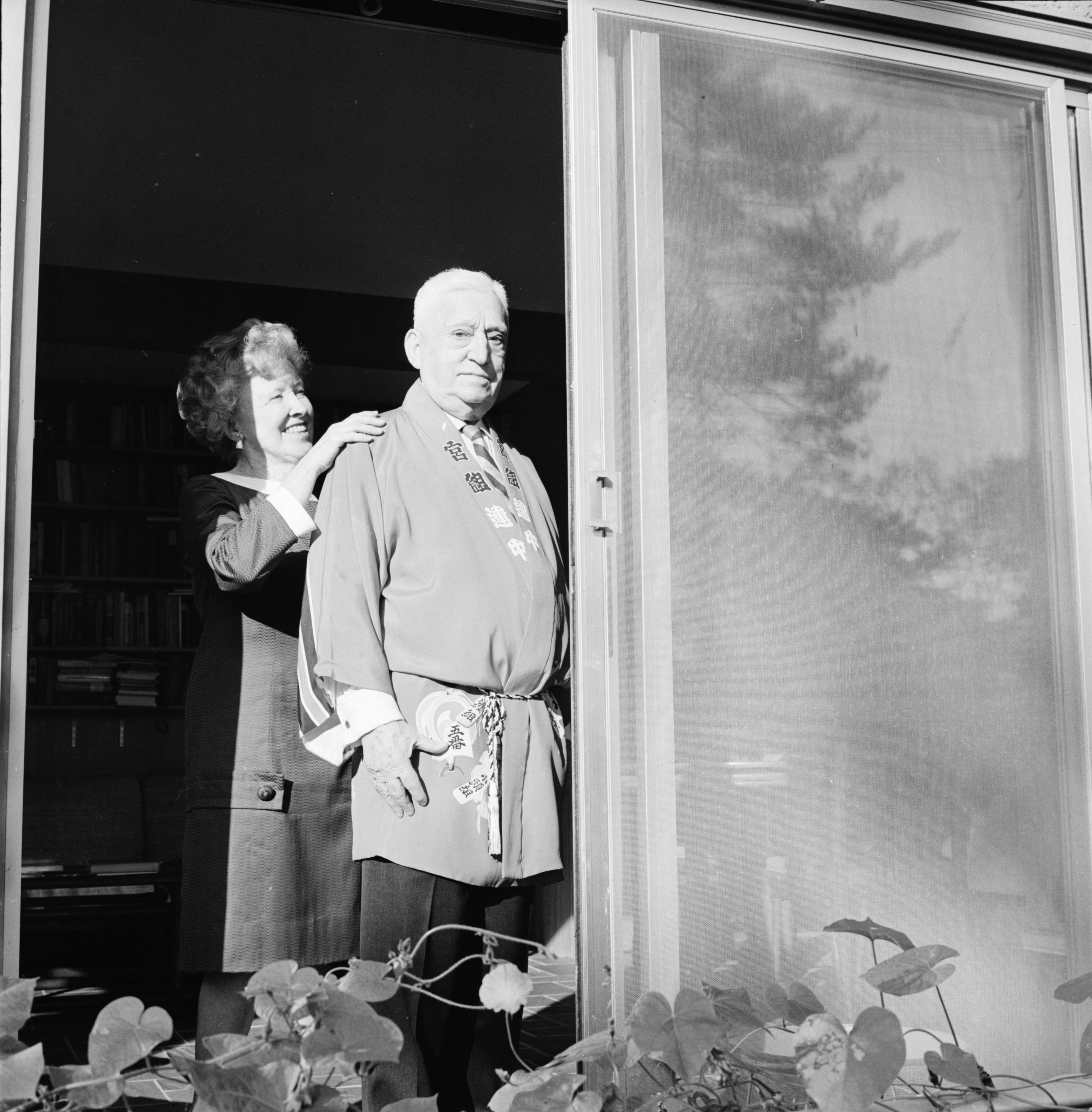 Mrs. Sink adjusts husband Charles A. Sink's coat prior to an early membership tea, October 1968 image