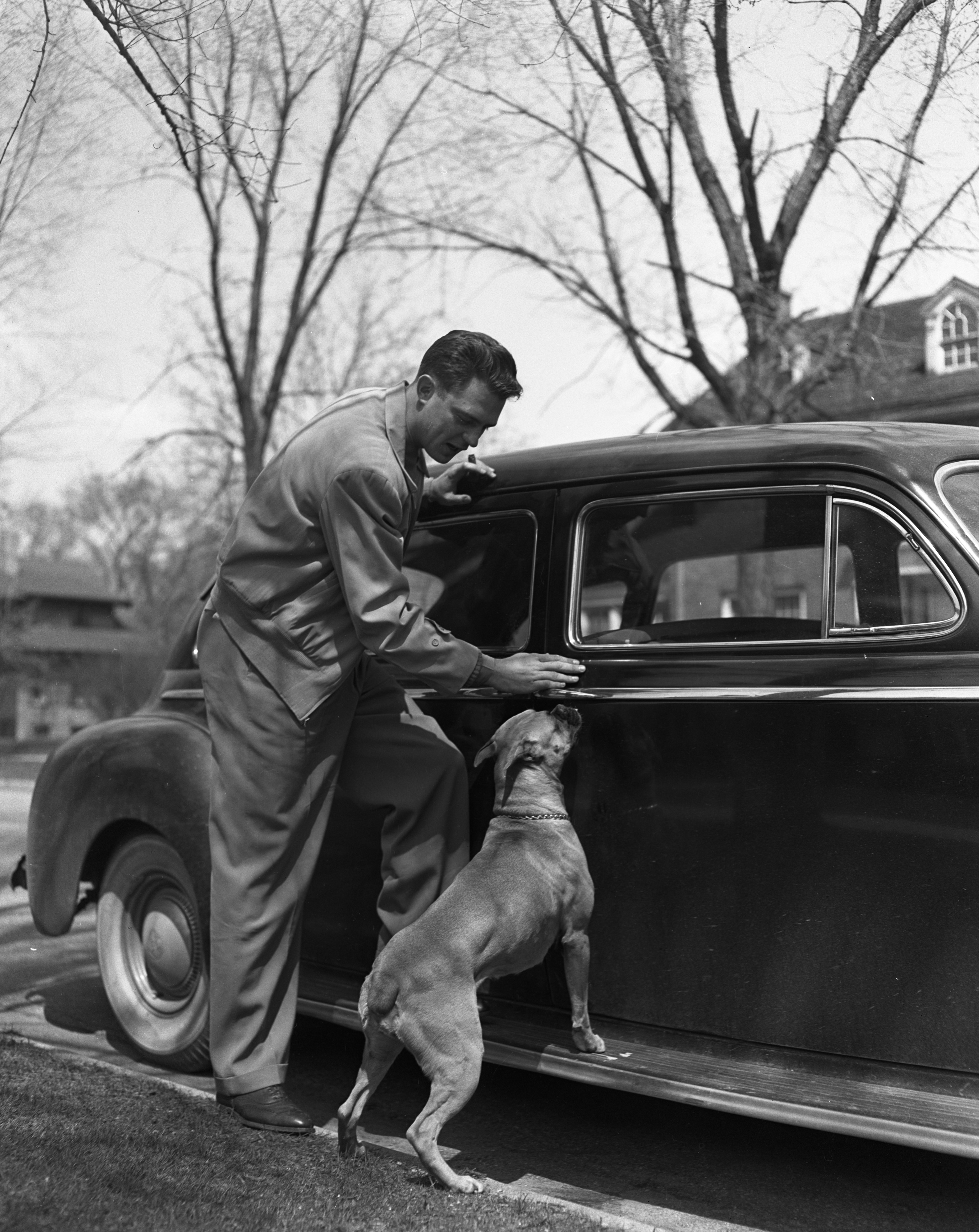 Former Detroit Tiger Dick Wakefield with his dog after the White Sox refused him, May 1950 image