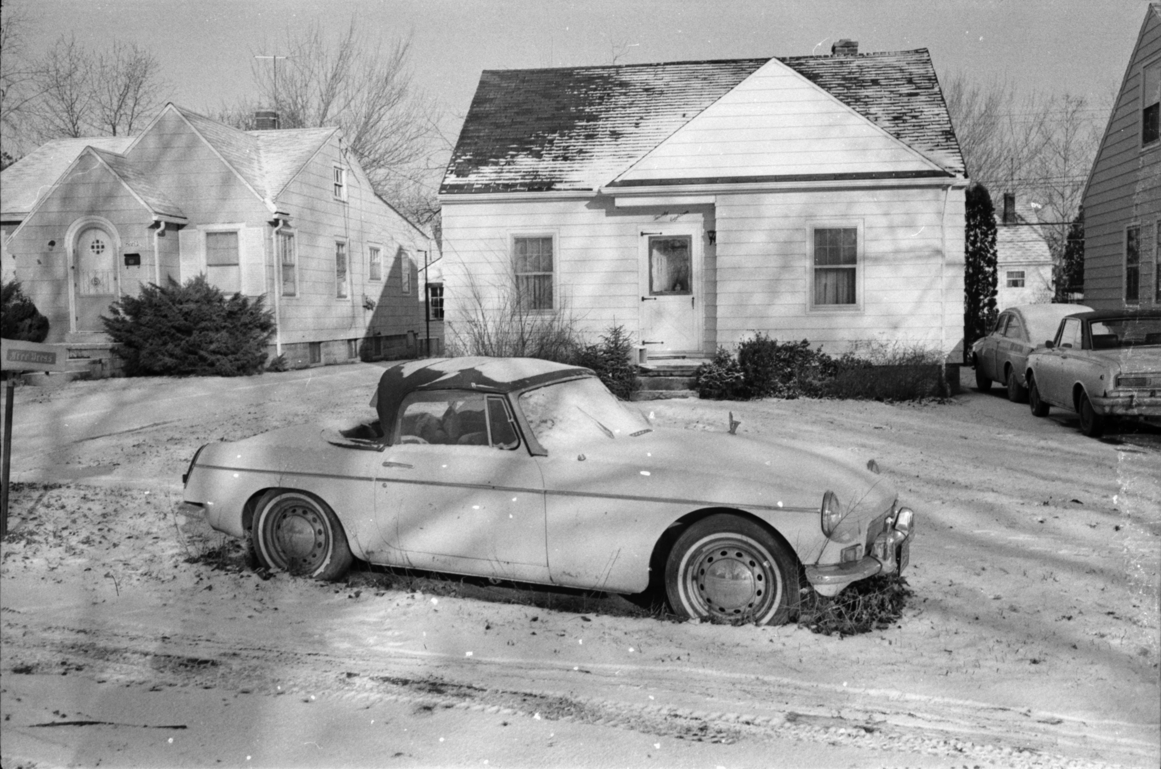 The old model sports car belonging to POW Captain James Warner is parked in the front yard of his parents' home at 2018 McKinley, January 1973 image