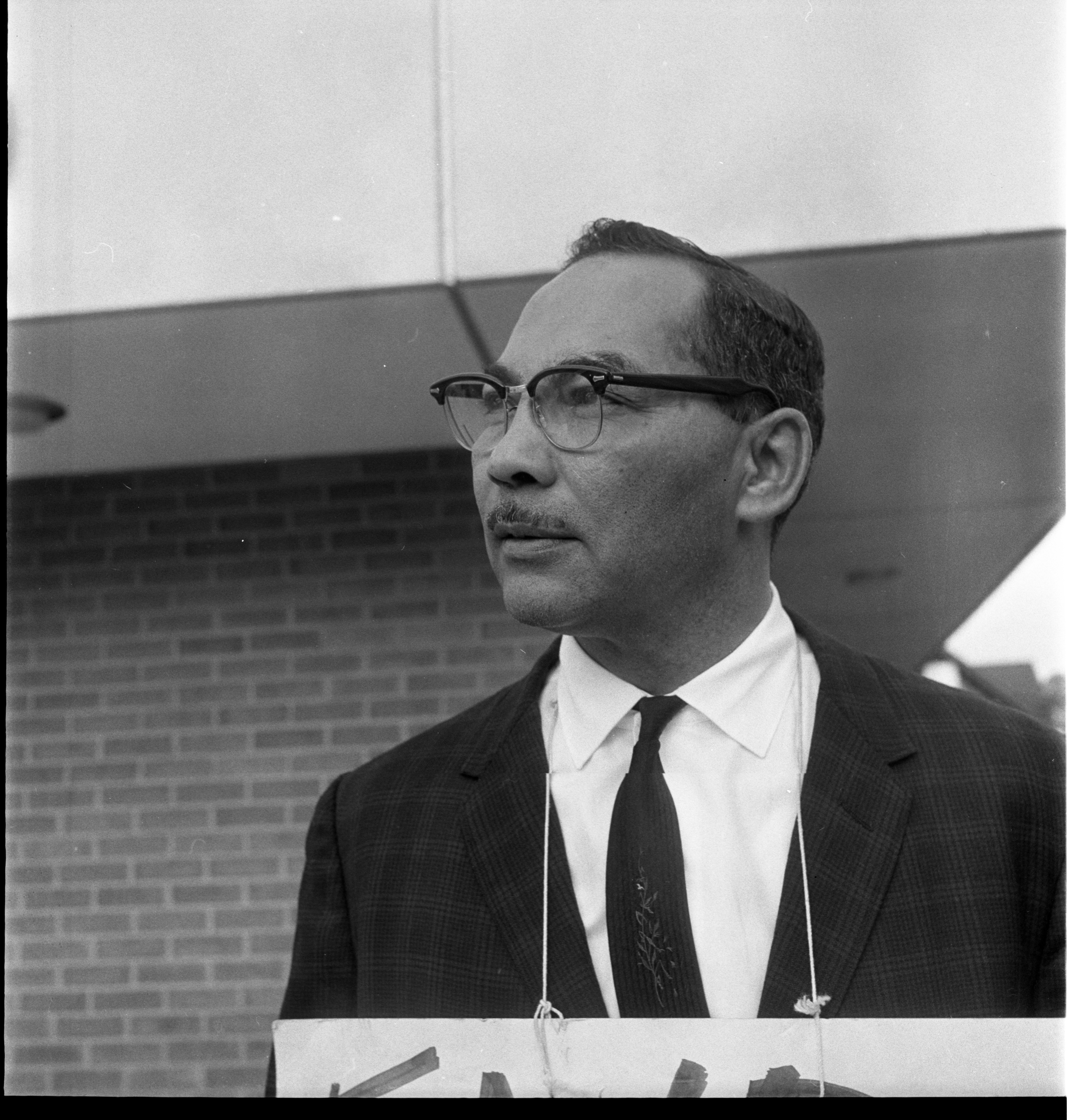 Dr. Albert H. Wheeler Picketing At Ann Arbor City Hall For Fair Housing, July 1963 image