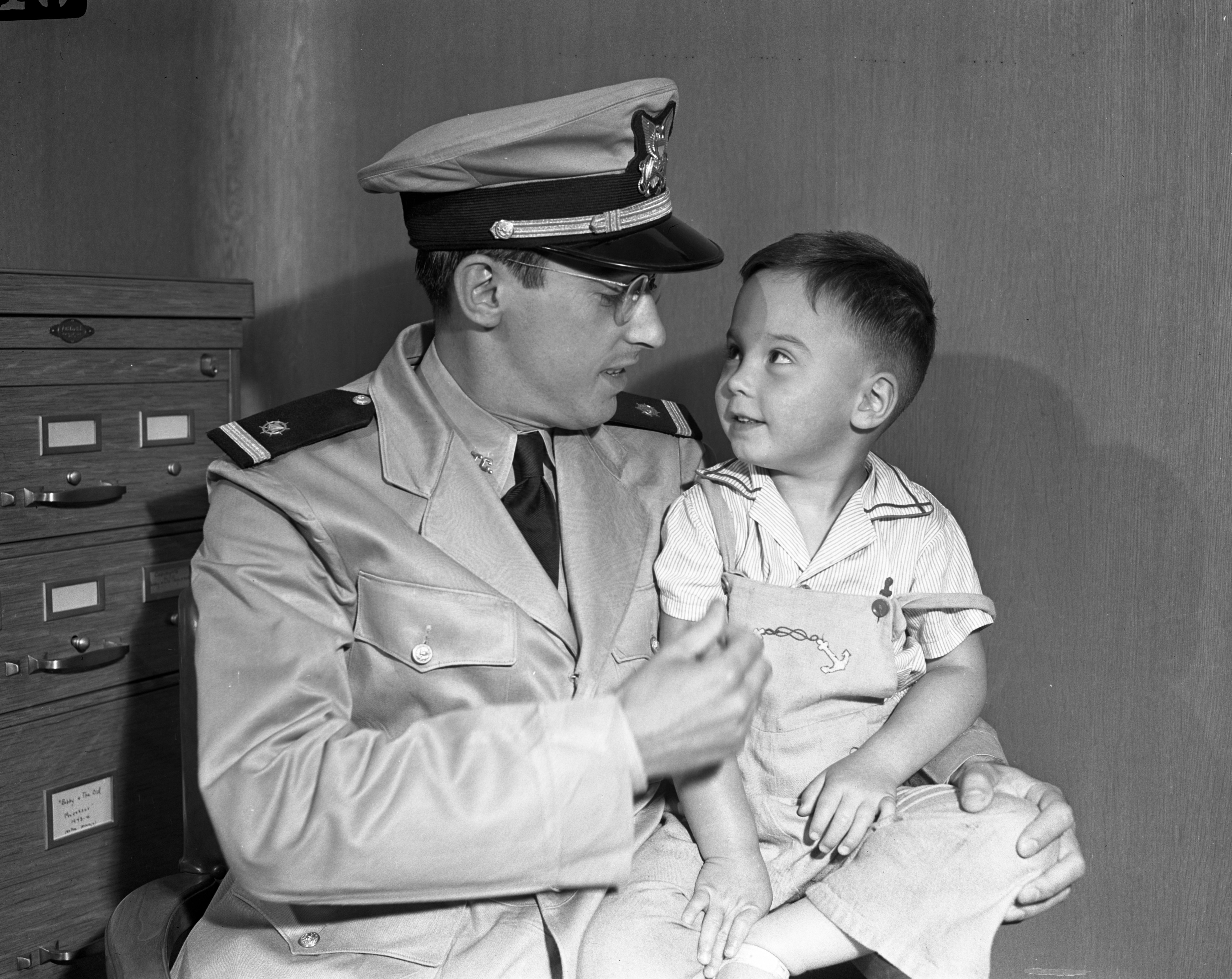 Junior Third Officer Robert F. Wurster, in the Army's Navy, and son Ernie, June 1945 image