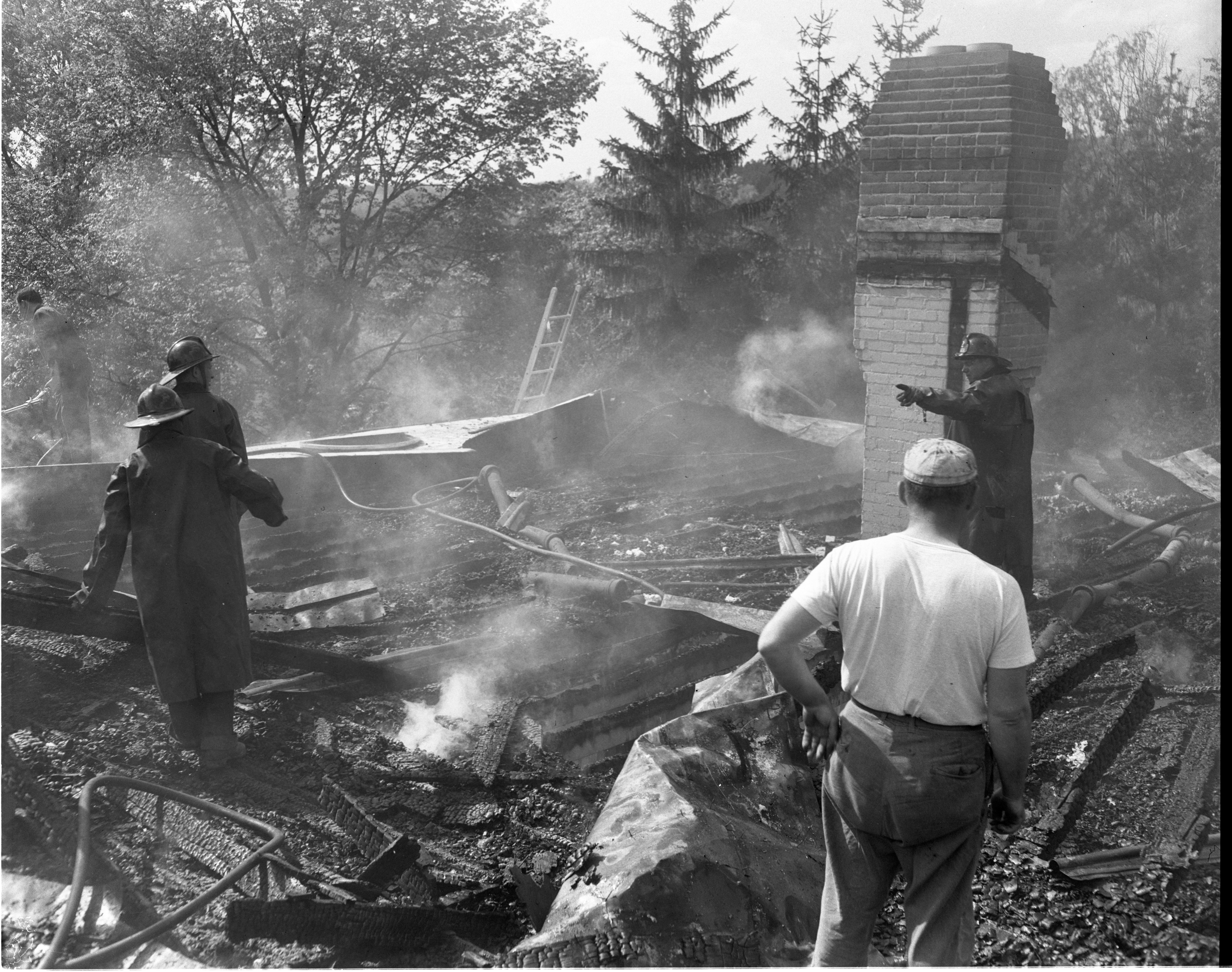 Firemen Work In The Former Attic of The Holmes Home At 175 Underdown Road, May 1953 image