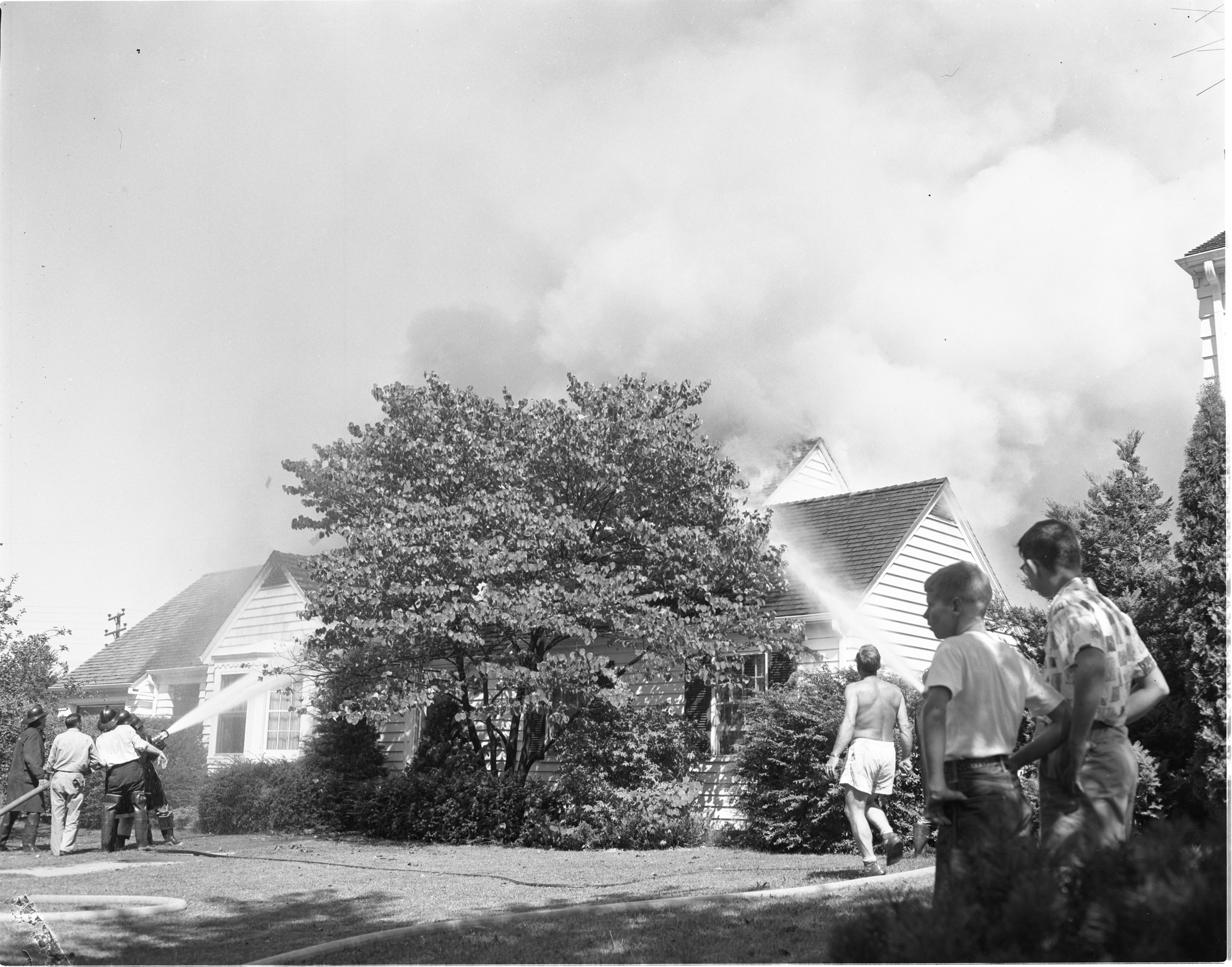 Neighbors Watch As Firemen Fight A House Fire At 2505 Brockman Blvd, September 1955 image