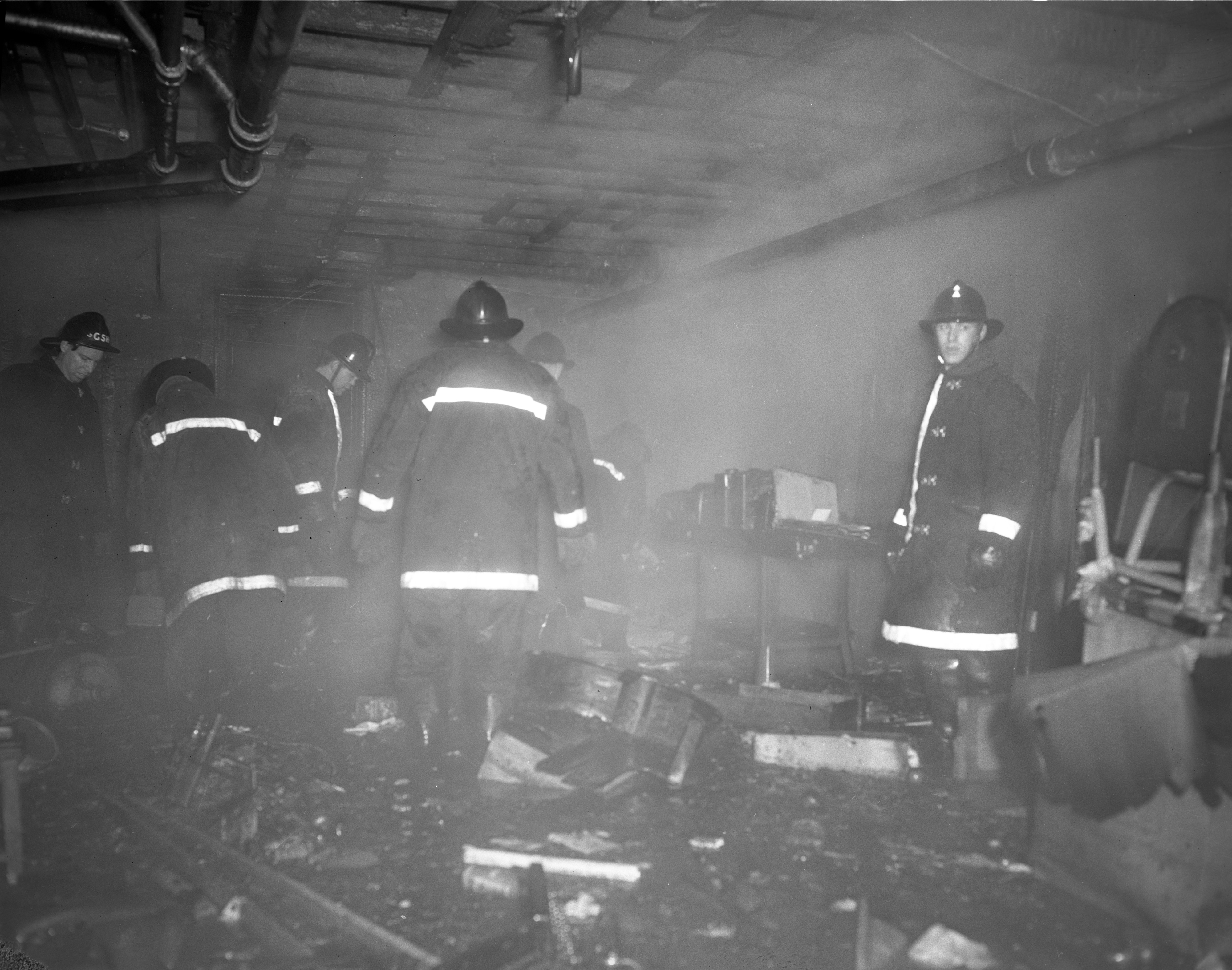 Firemen Amid the Wreckage at the Embassy Hotel Fire, February 1961 image