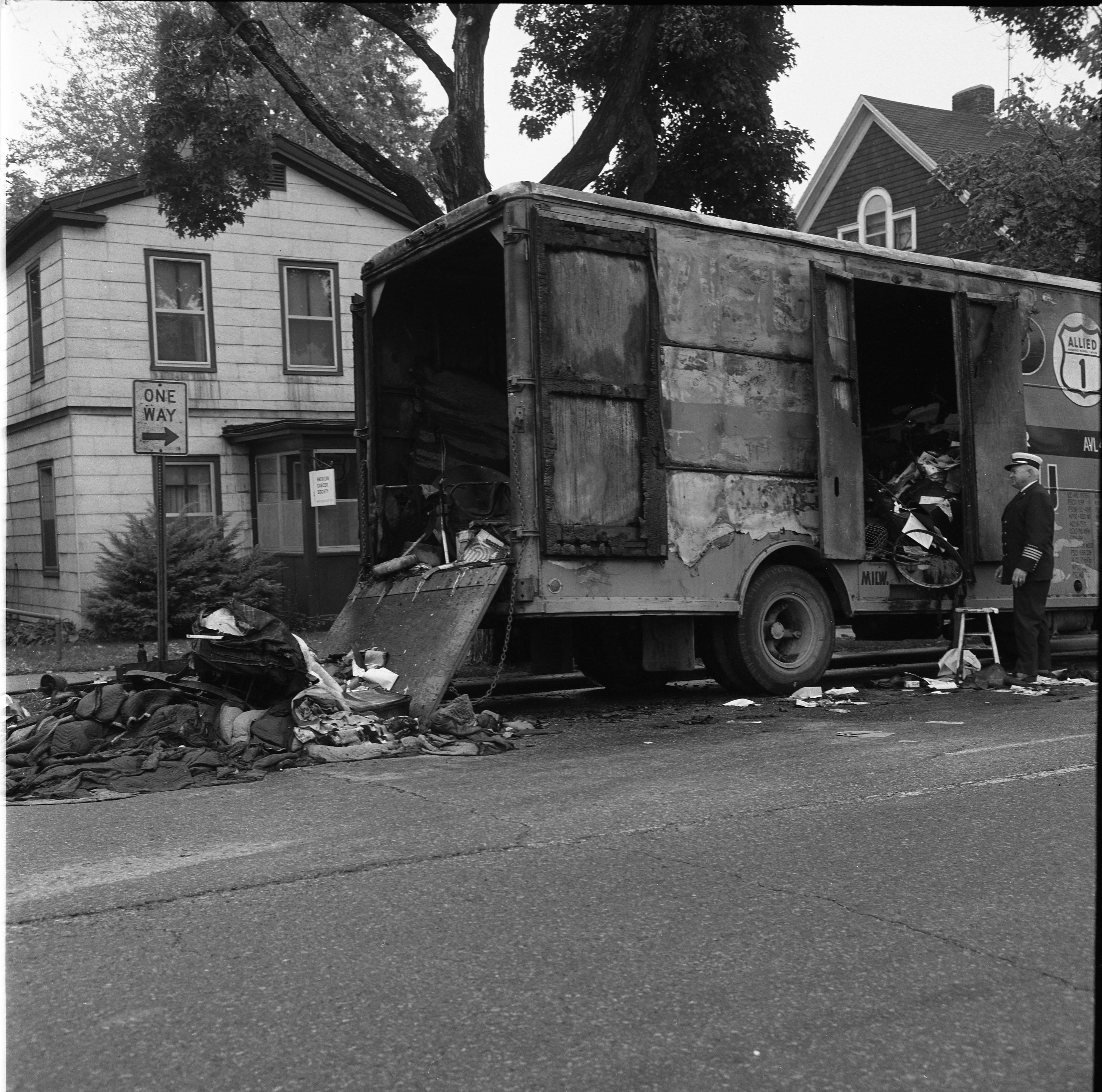 Fire Chief Arthur Stauch Inspects Remnants Of Allied Moving Van Fire On N. Ashley, September 1966 image