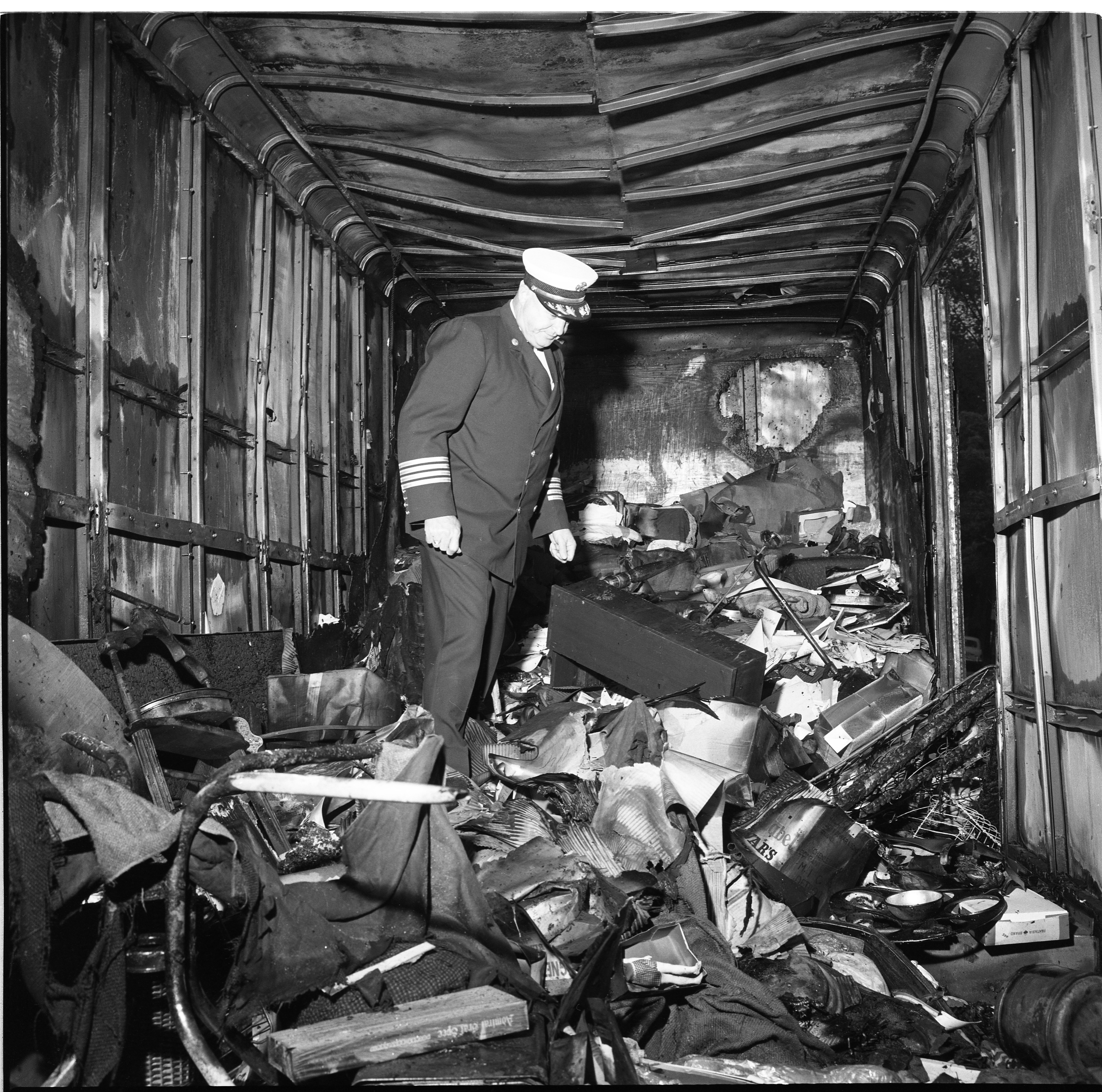 Fire Chief Arthur Stauch Inspects Interior Remnants Of Allied Moving Van That Caught Fire On N. Ashley, September 1966 image