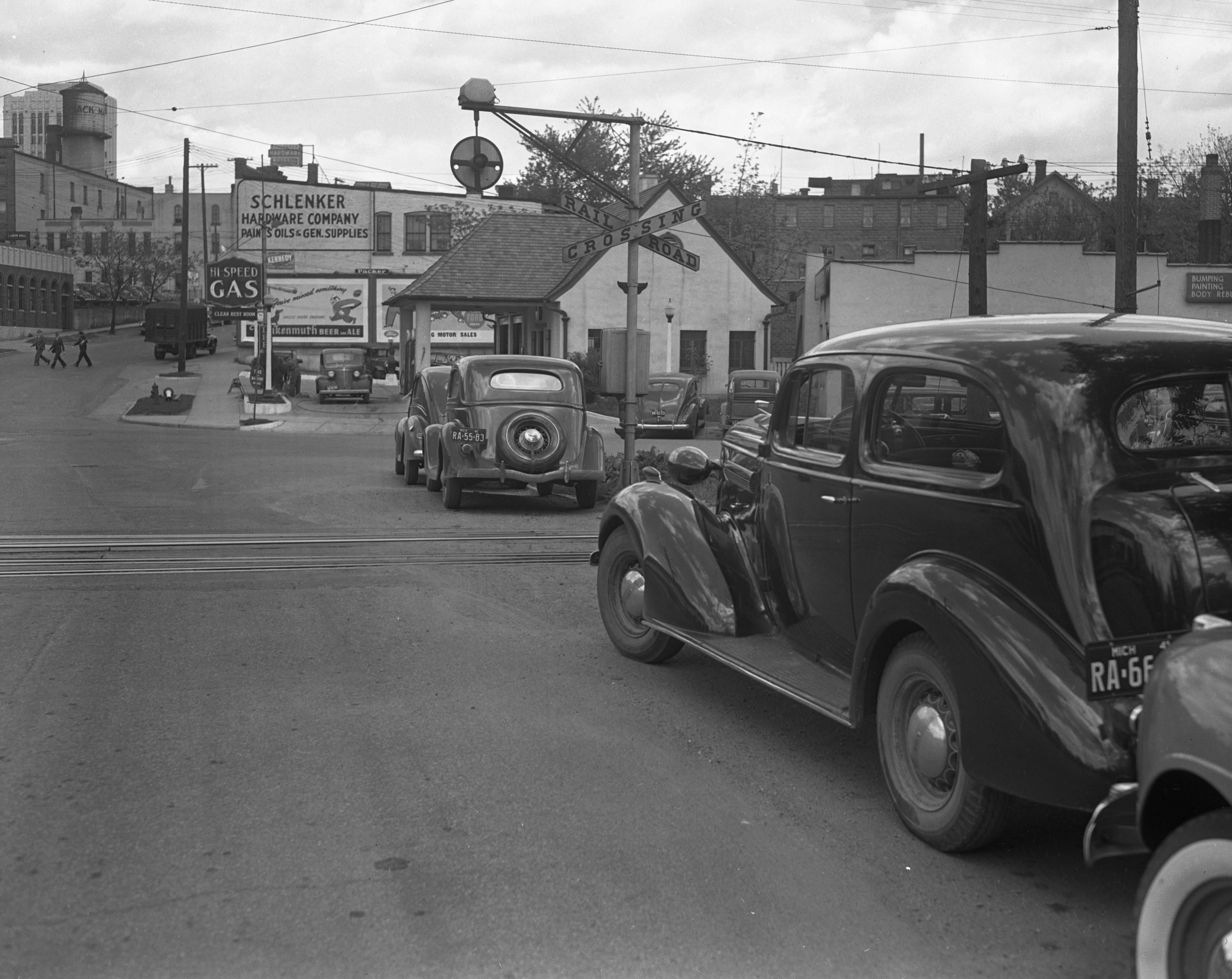 Cars Parked Near Ann Arbor Railroad Crossing at First and Liberty Create Traffic Hazard, 1941 image