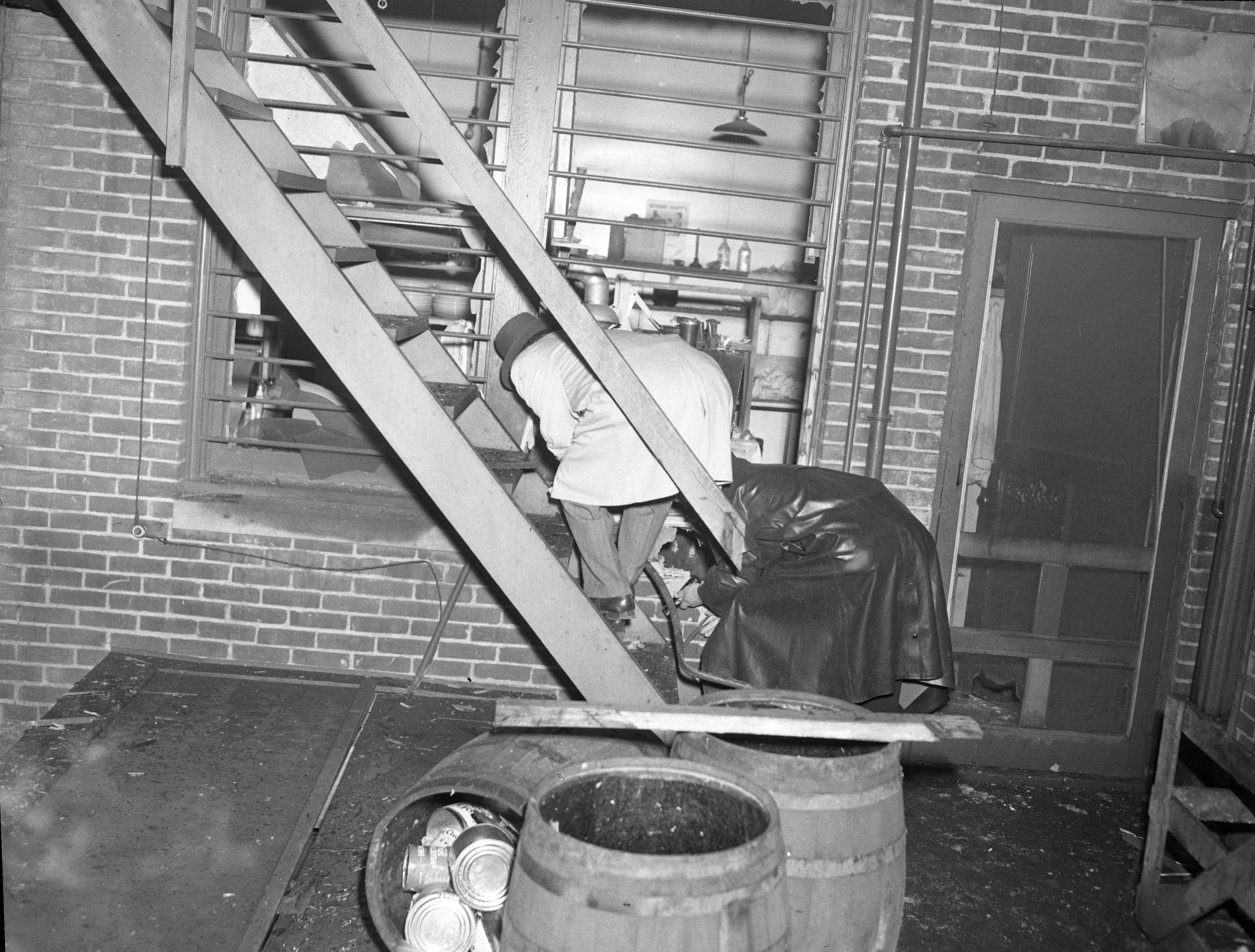 Ann Arbor Police Department Officers Inspect Mary Lee Candies Shop on South State Following Explosion, May 1947 image