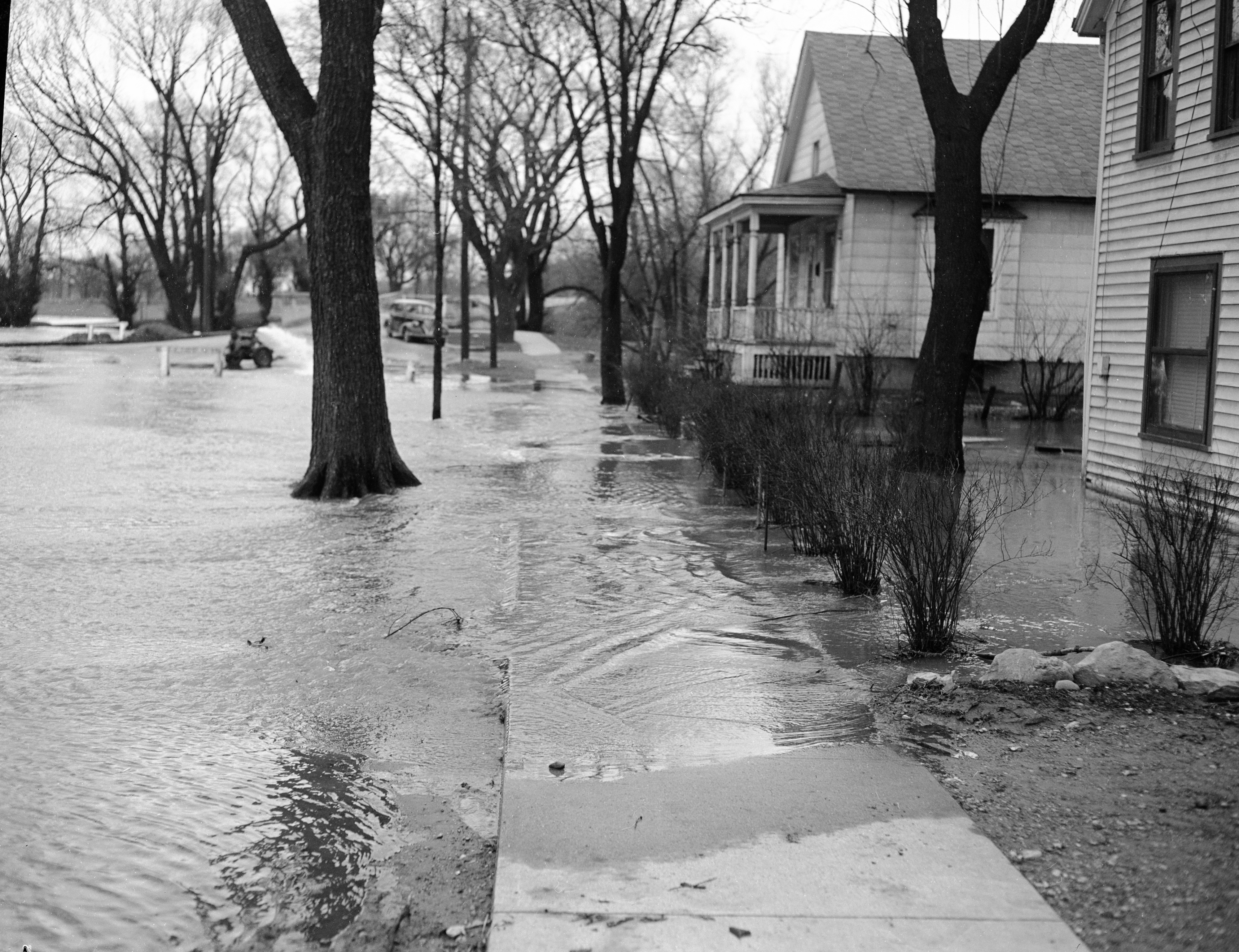 Streets In Wall Street Neighborhood Flooded By Overflowing Huron River, April 1950 image