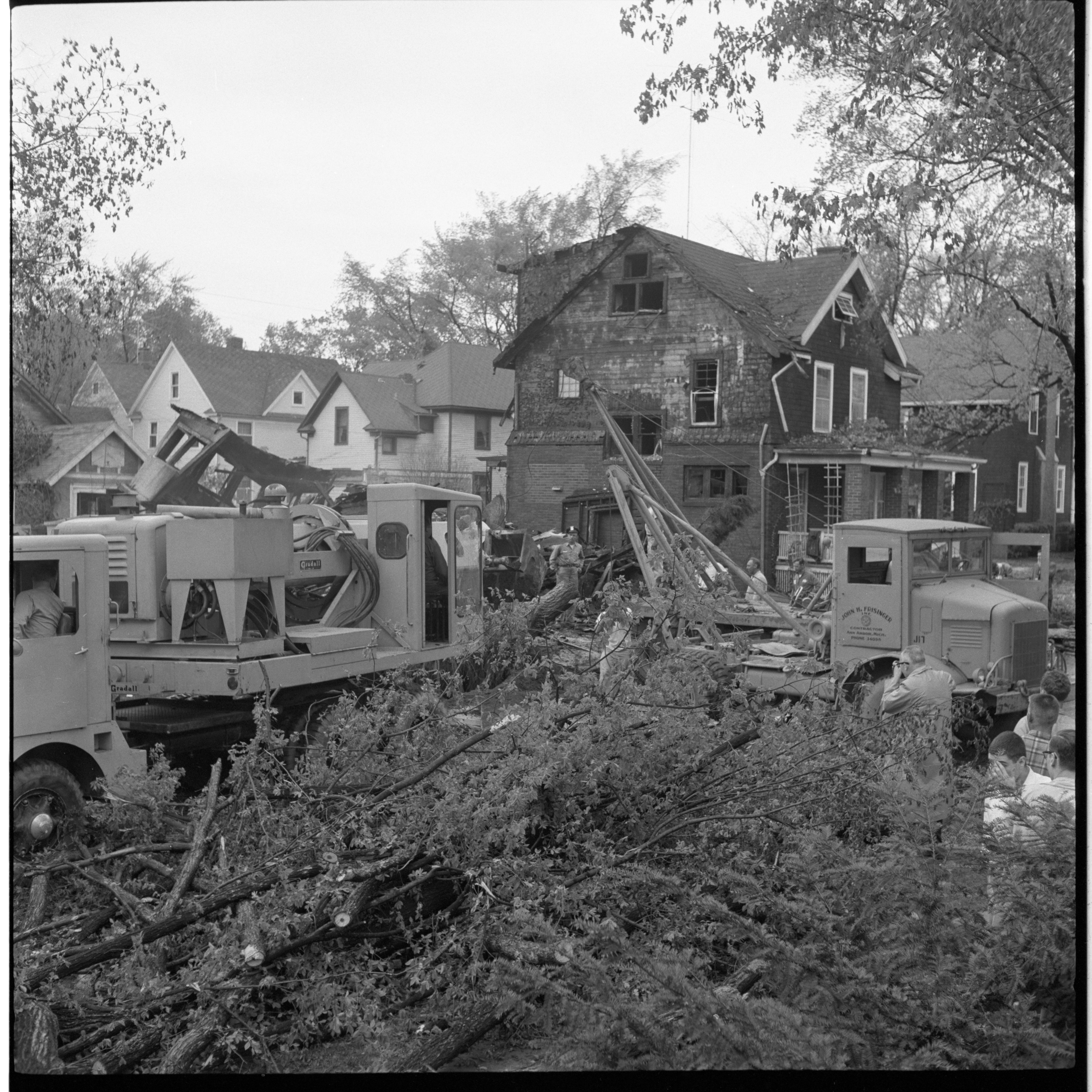 Residents Work To Clean Up Brookwood Place After Windstorm, May 1959 image