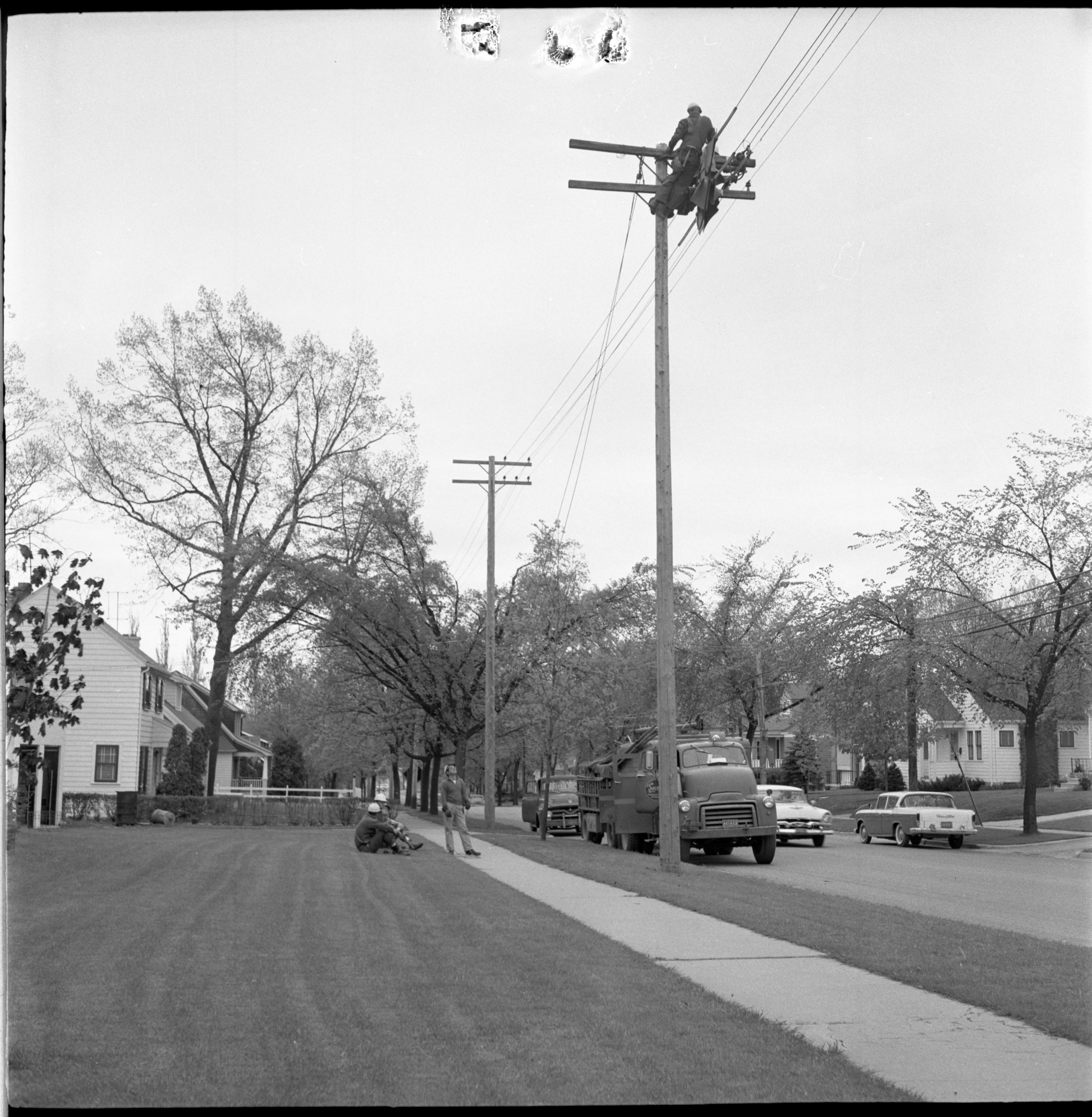 Detroit Edison Workers Restore Electrical Service Lost In The Windstorm, May 1959 image