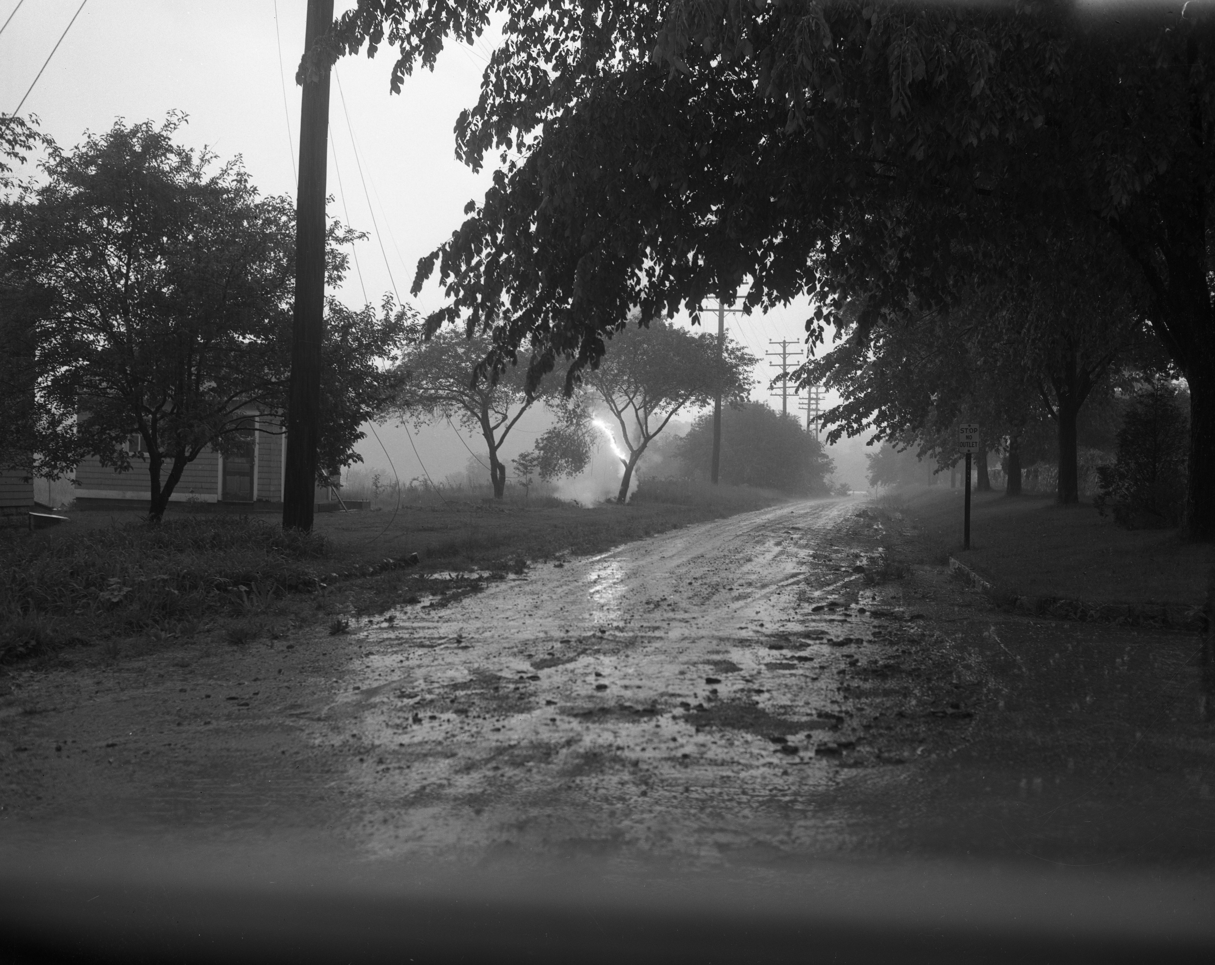 Smoldering Ground Where Lightning Hit Near Kellogg And Wright Streets During Storm, June 1954 image
