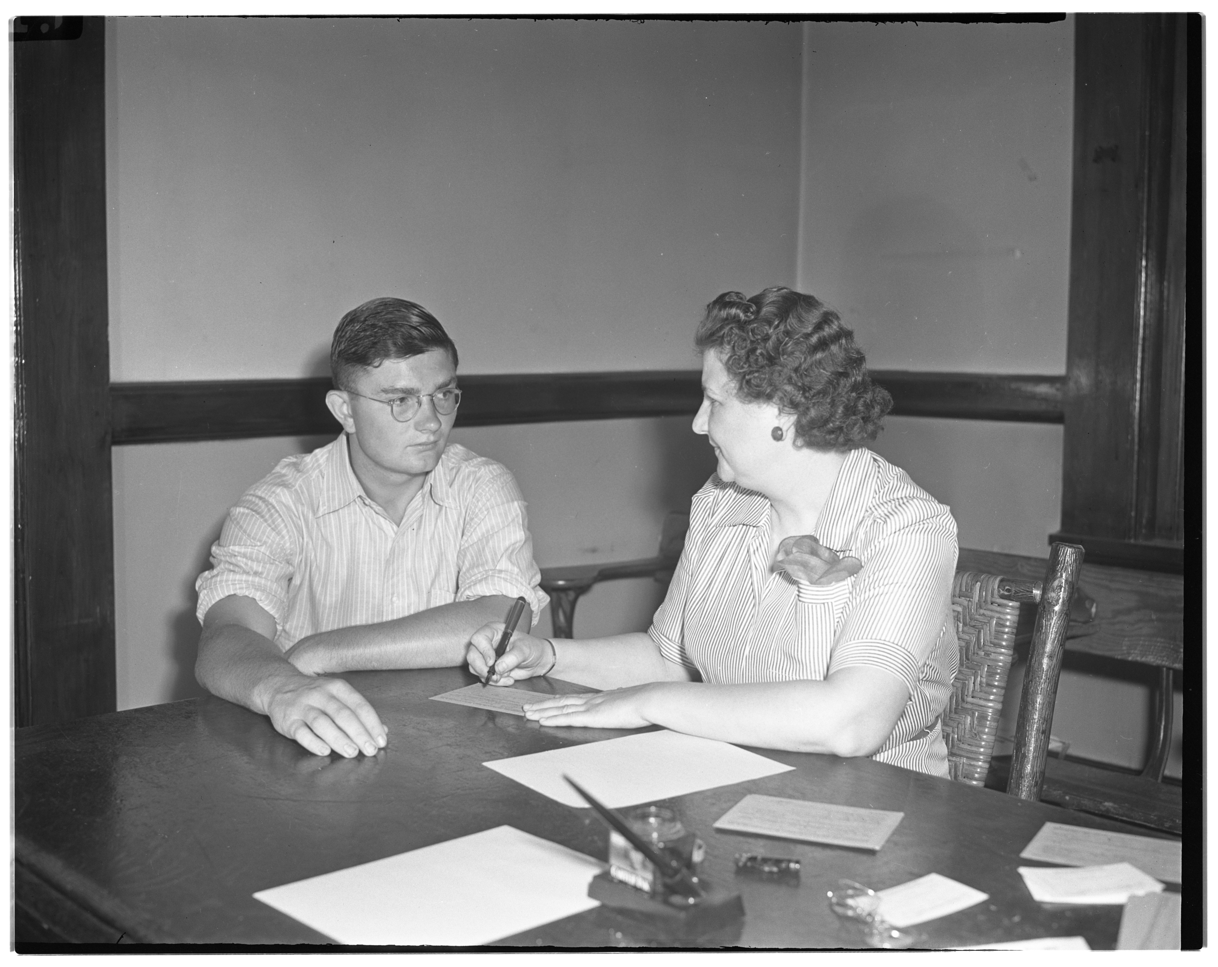 Gertrude Nickels registers her son, Robert, for selective service, June 1942 image