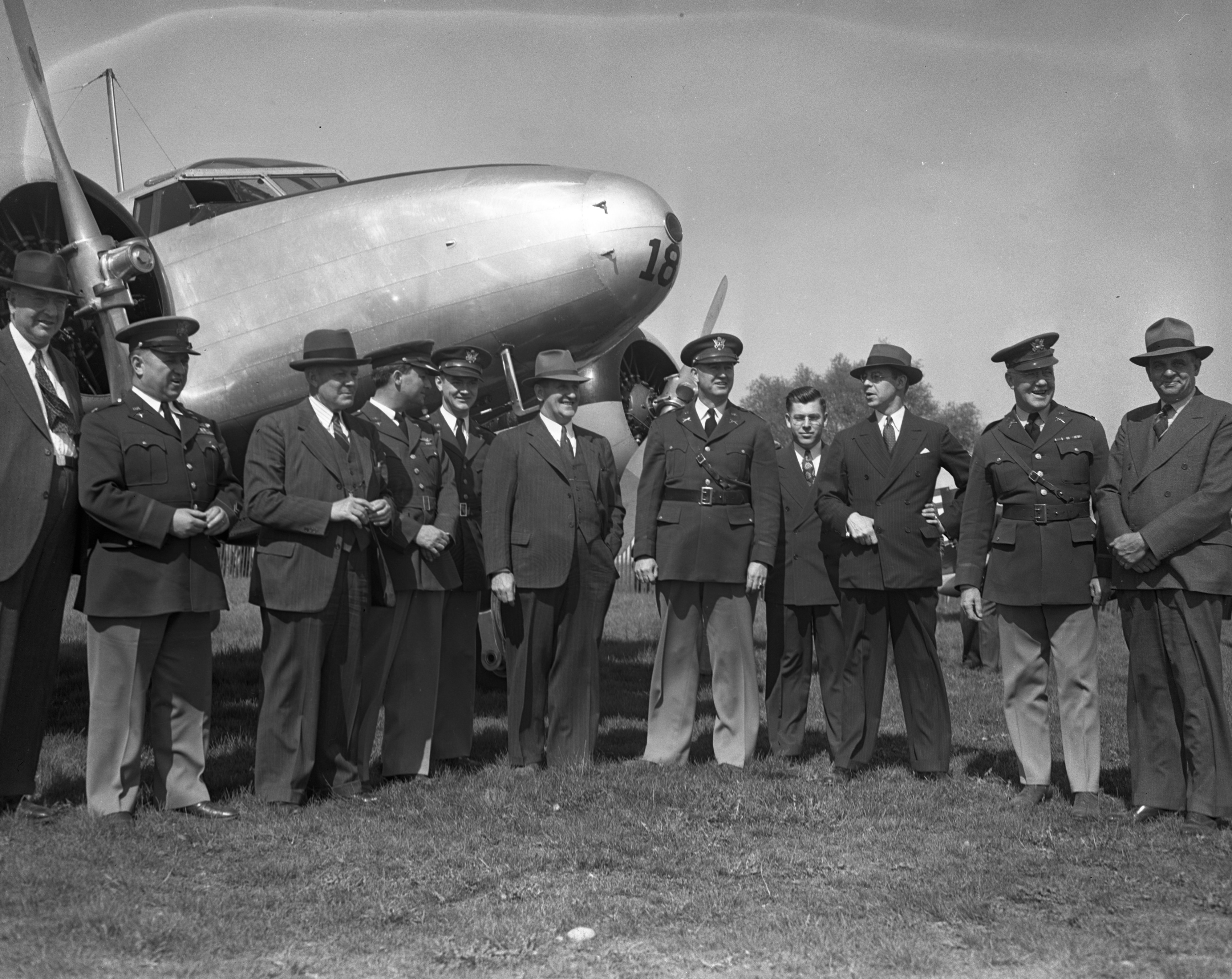 Army Planes (Airacobras) and Army Medical Officers with plane mired at Ann Arbor Airport, 1941 image