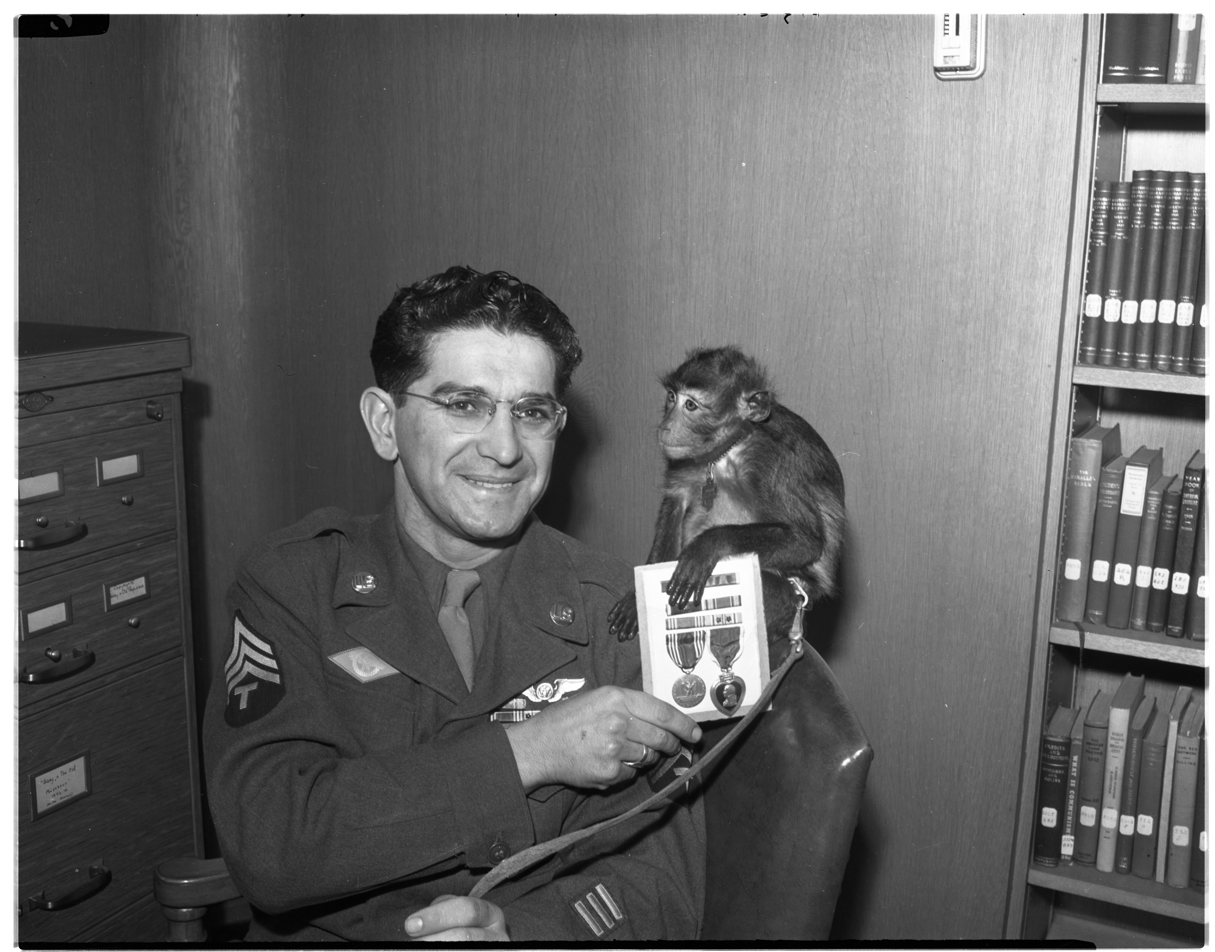 Sgt. Anthony V. Grammatico With First Sgt. Pat P. Pat, February 1946 image