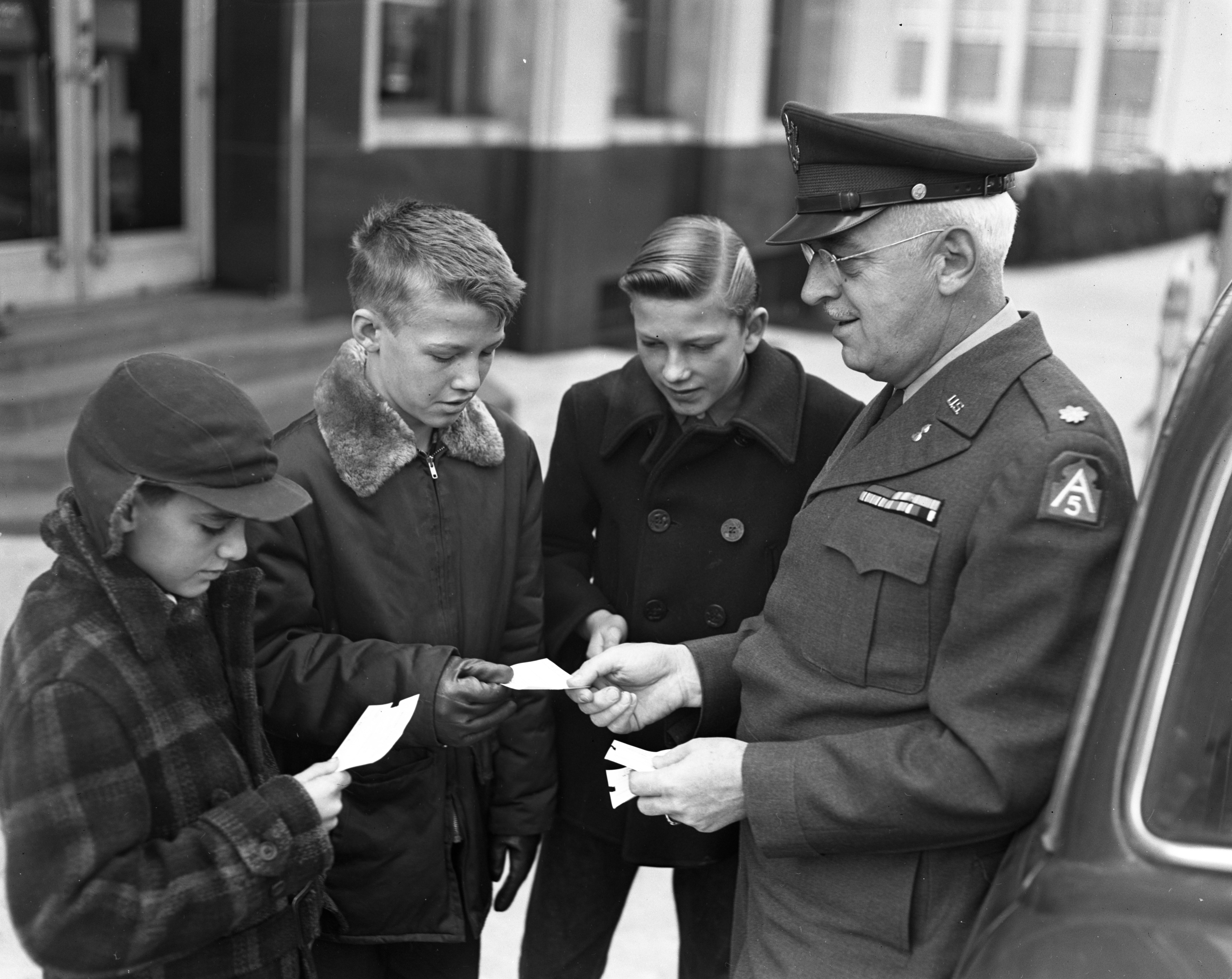 Local National Guardsman gives tickets to newsboys for circus, November 1951 image