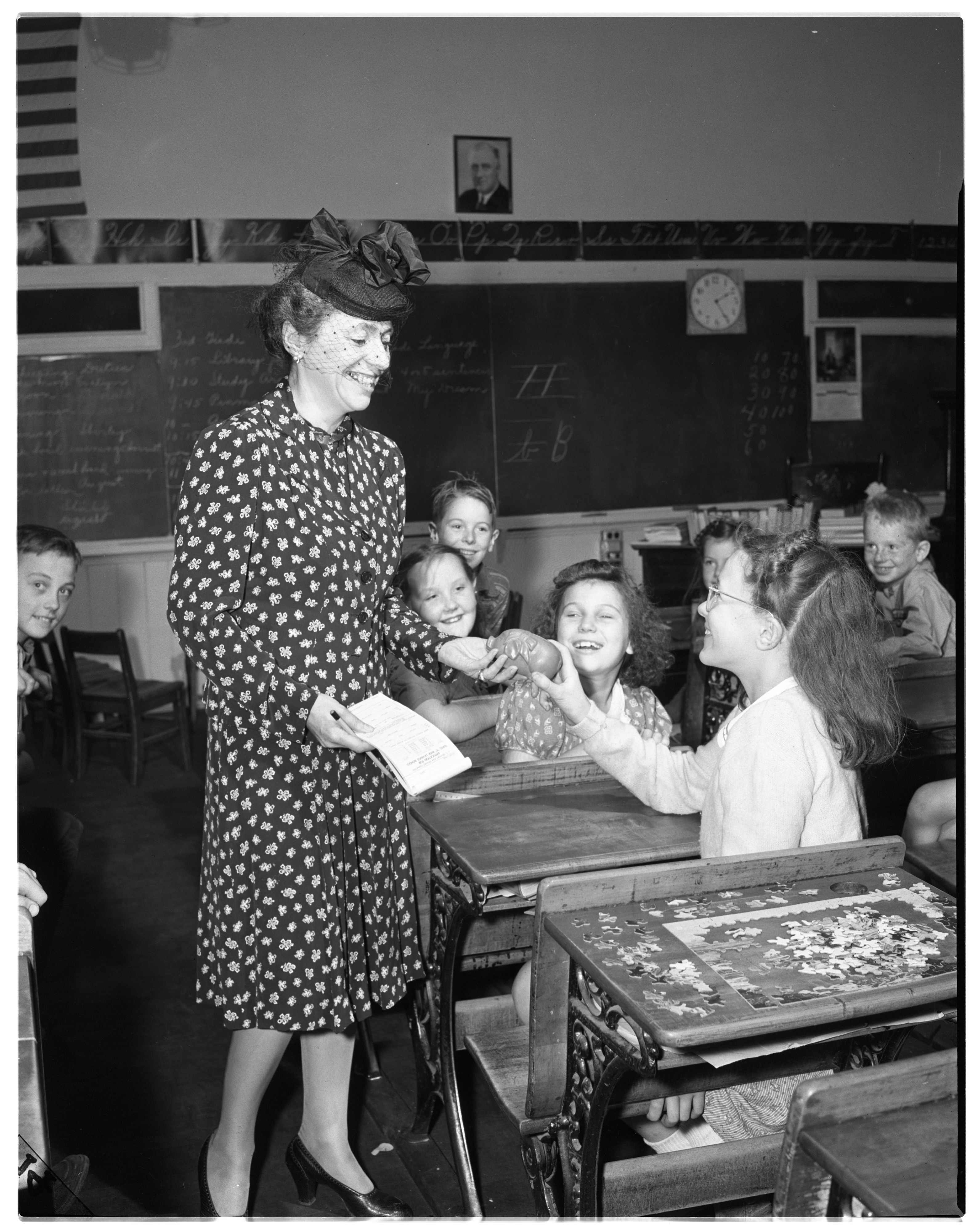 Phoebe Frederick Buys Bond From Piggy Bank at Popkins School, September 1943 image
