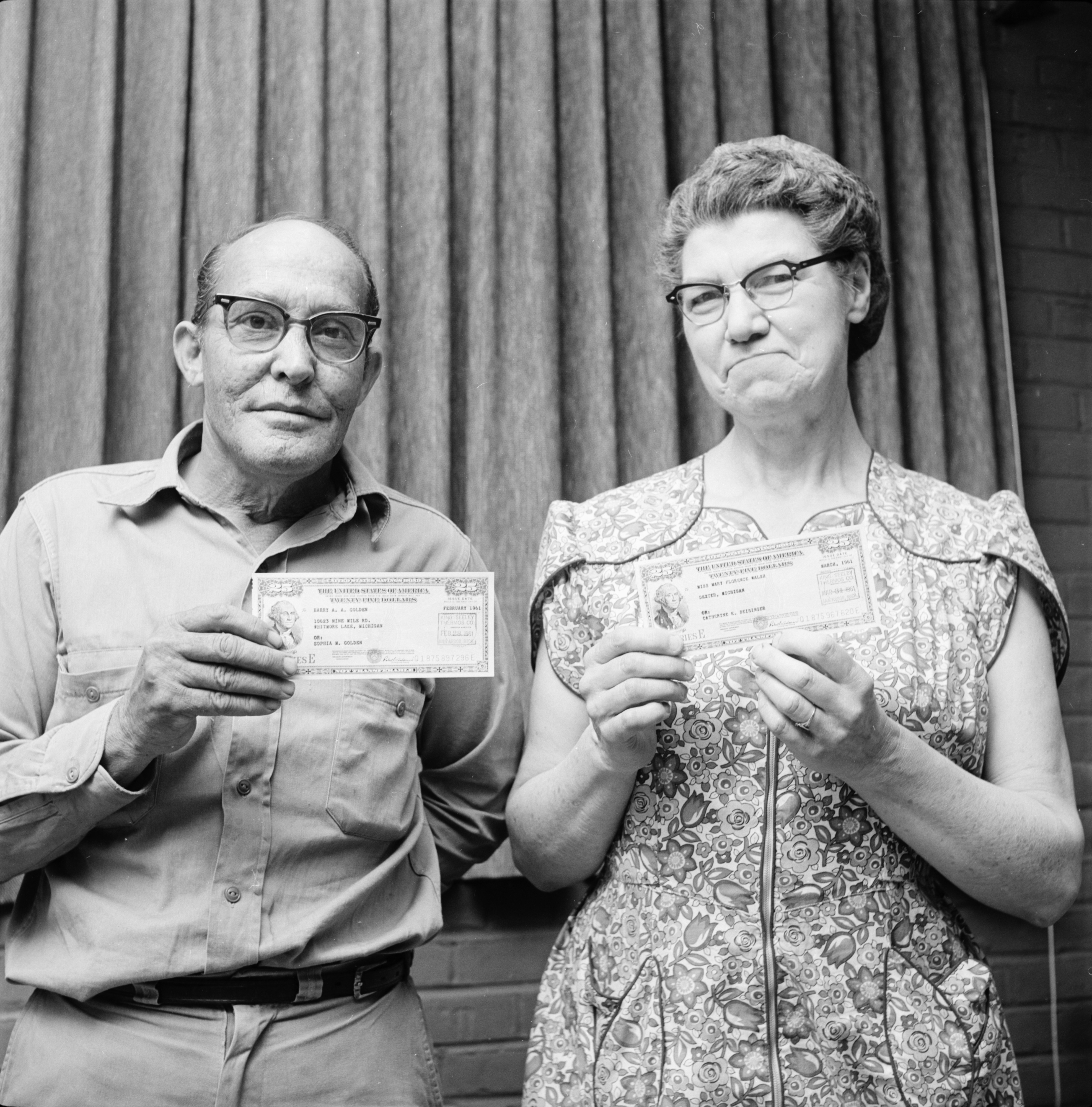 Harry Golden and Florence Walsh of King-Seeley Thermos Co. show U. S. Savings Bonds like those they've been purchasing every month since World War II, May 1961 image
