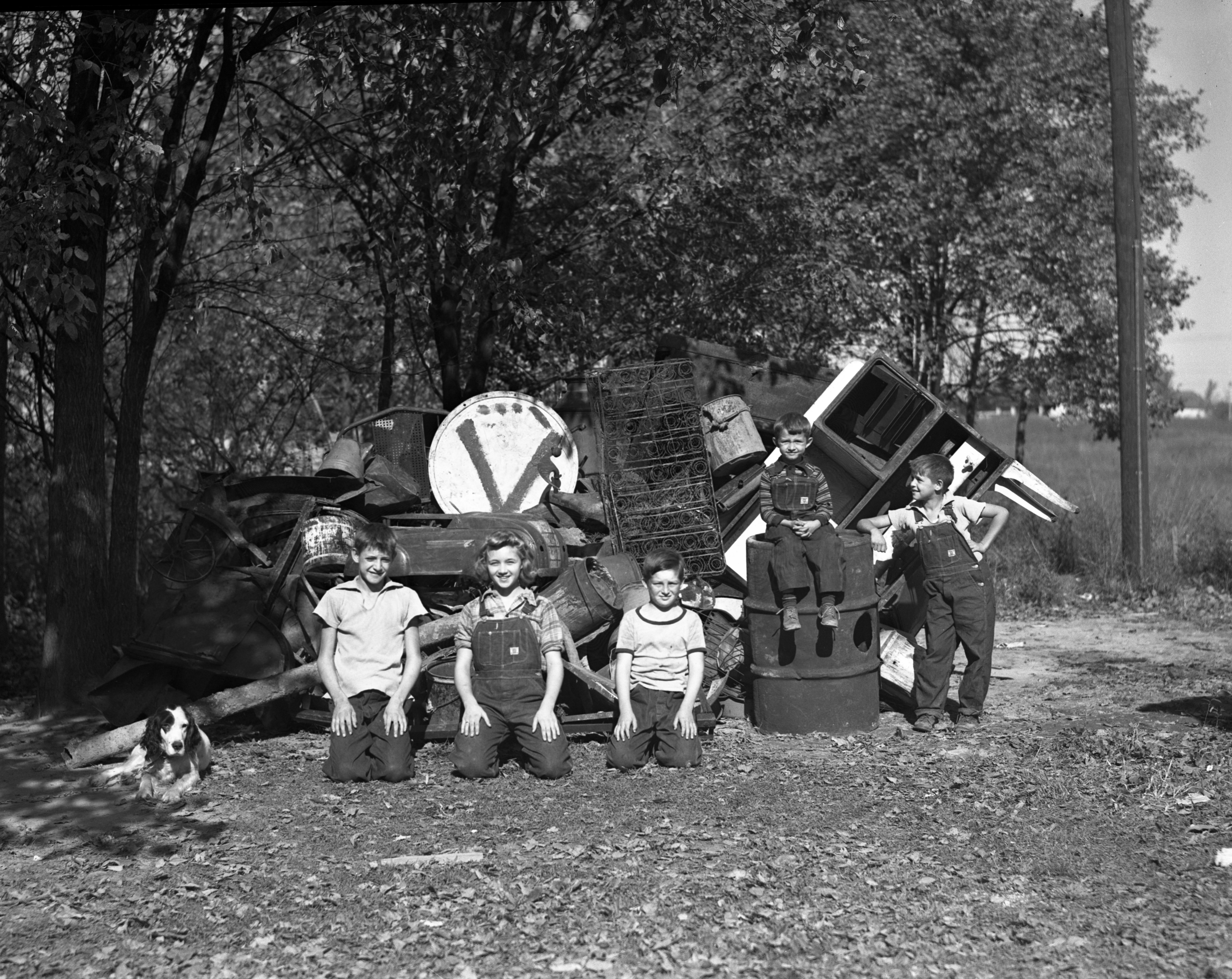 Park Road kids pose with their scrap pile, October 1942 image