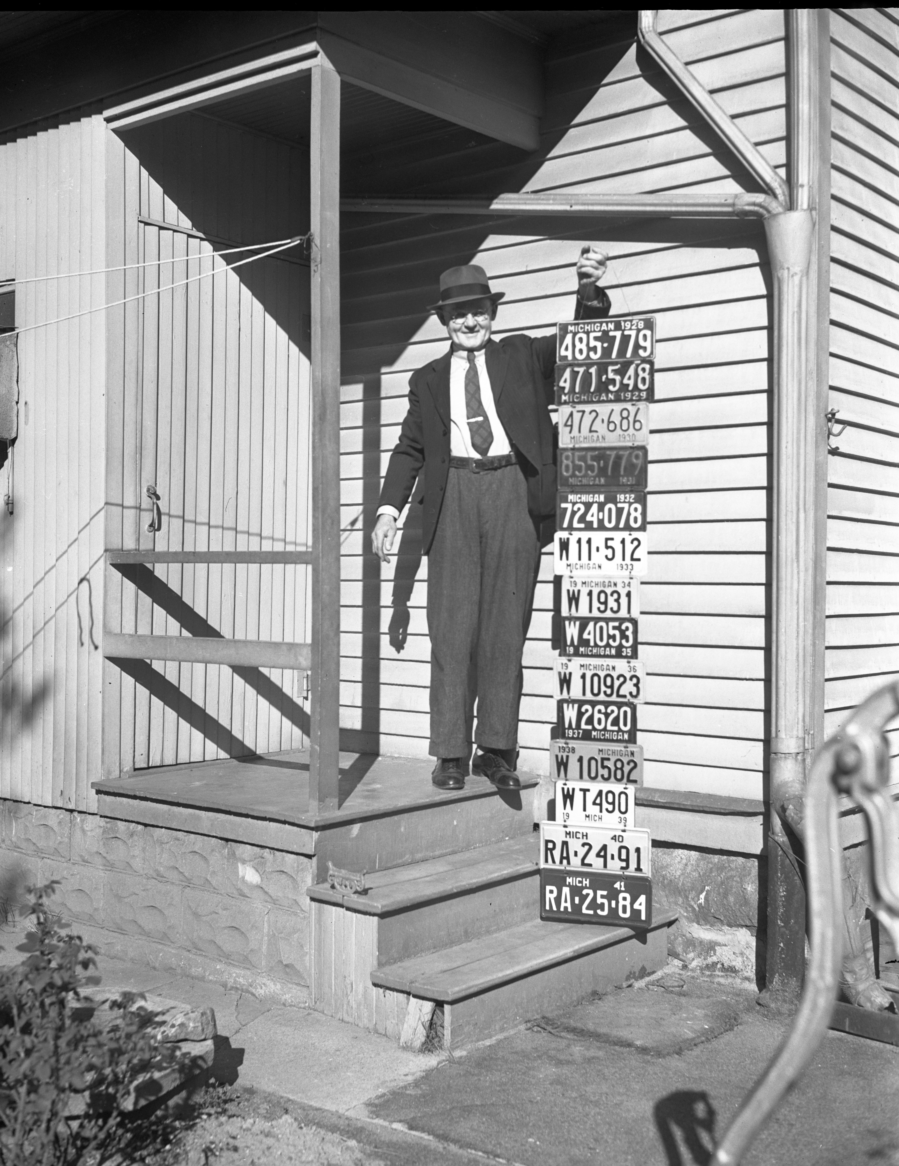 Henry Backhaus With License Plate Collection For Scrap Drive, September 1942 image