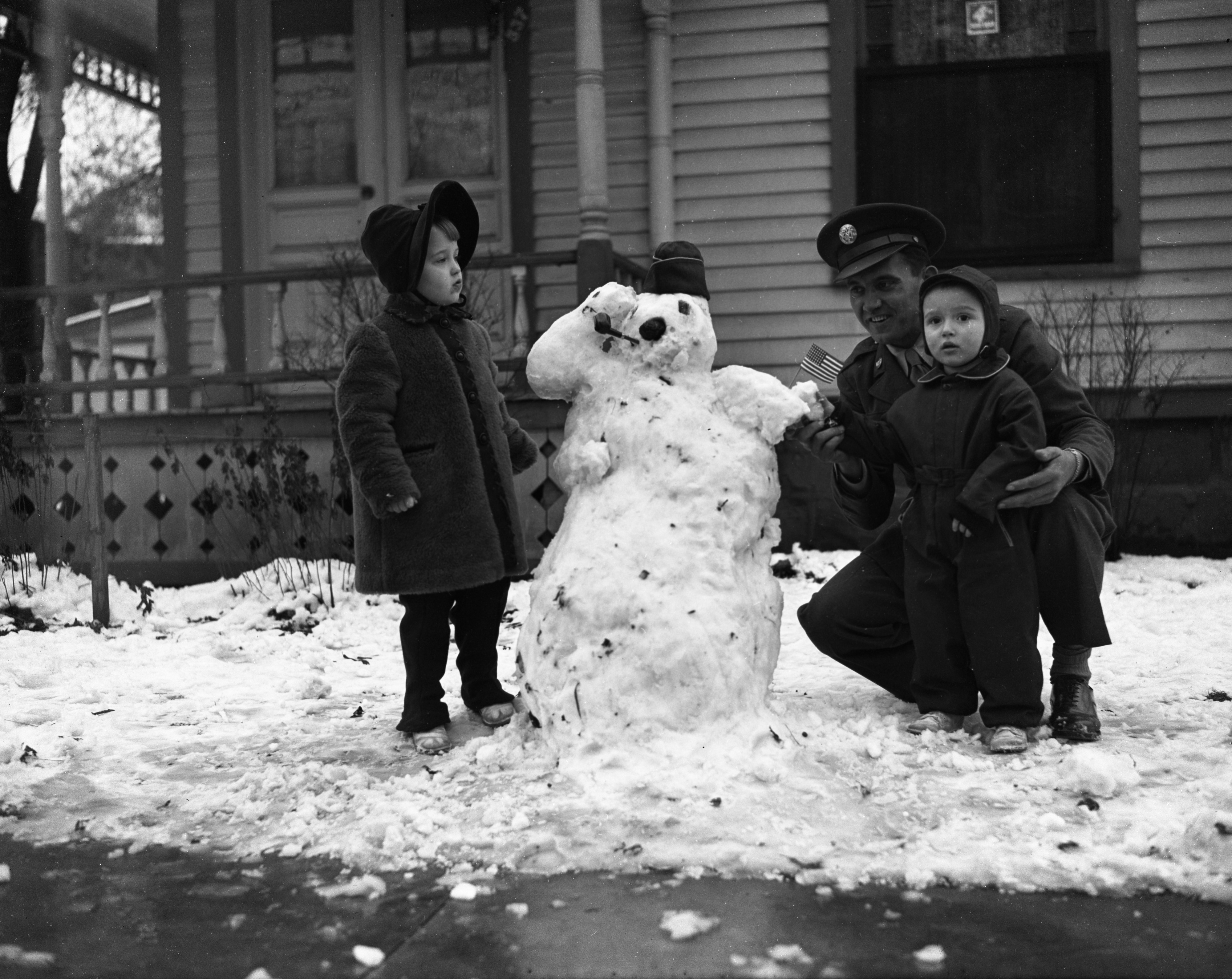 Johnny & Marcia Ann Flis, Together With Their Uncle Joe Yanitsky, Build A Snowman For V-Mail, February 1944 image