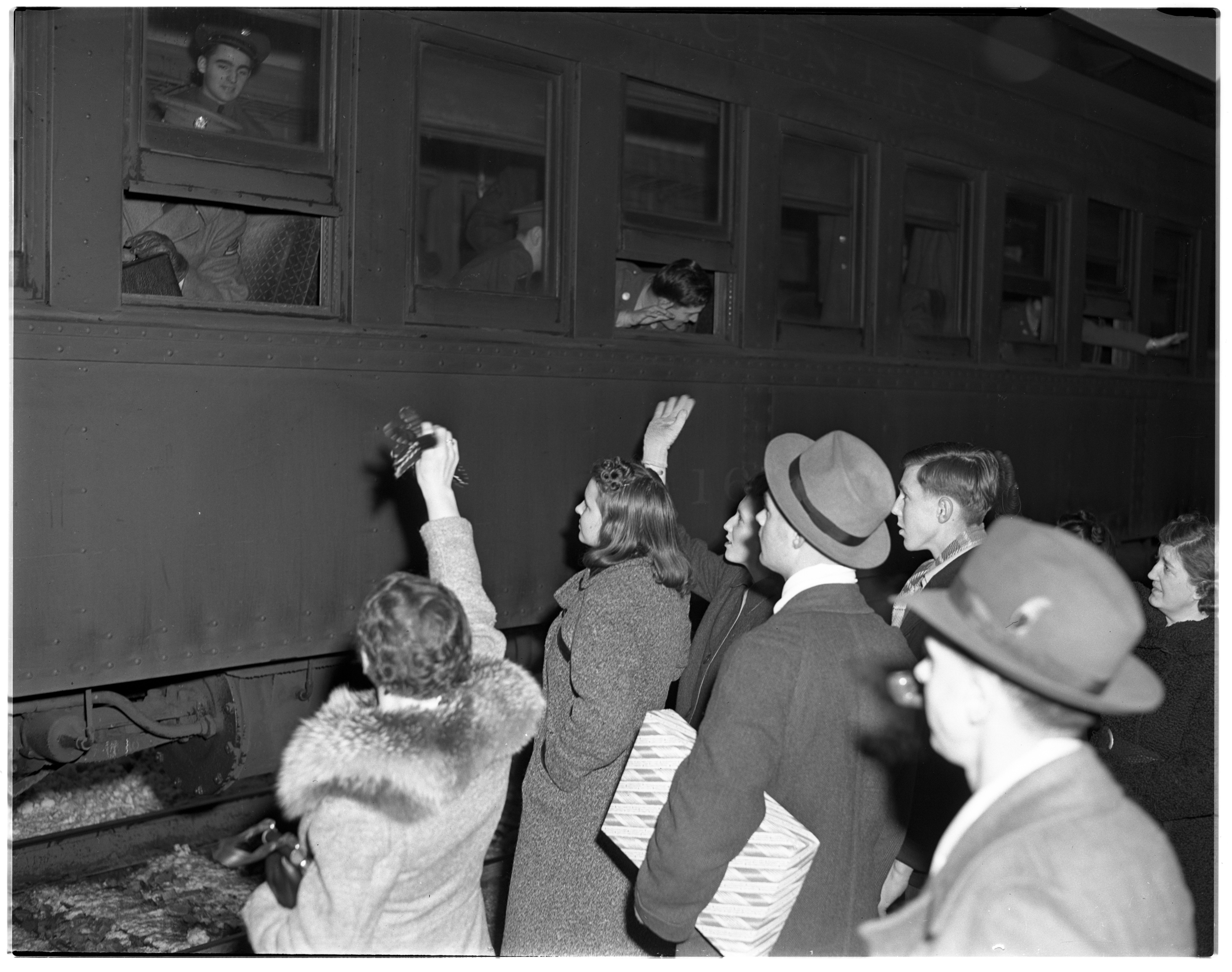 Soldiers' Families Wave Prior to Departure, January 1941 image