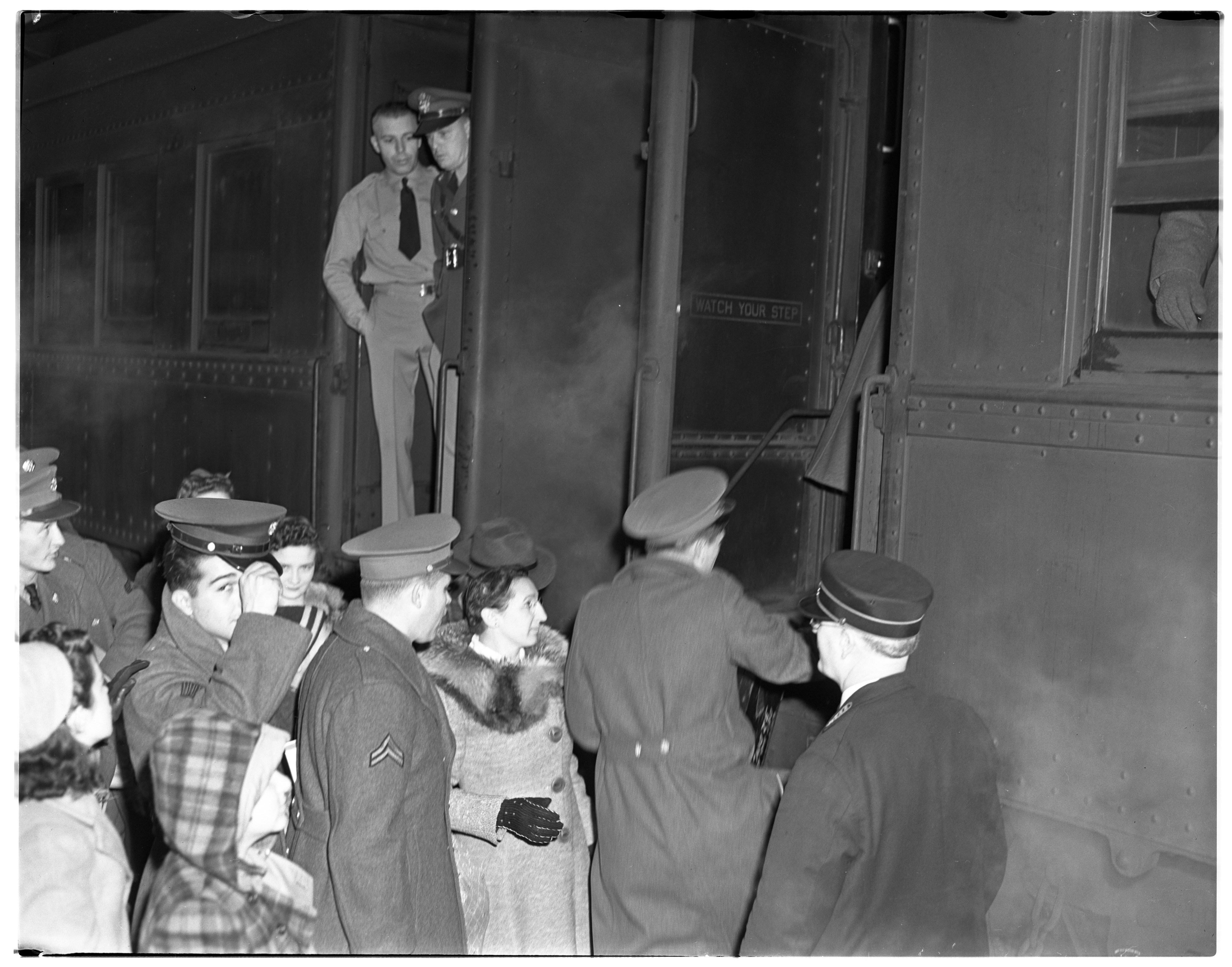 Soldiers Board Train Back for Camp After Christmas, January 1941 image