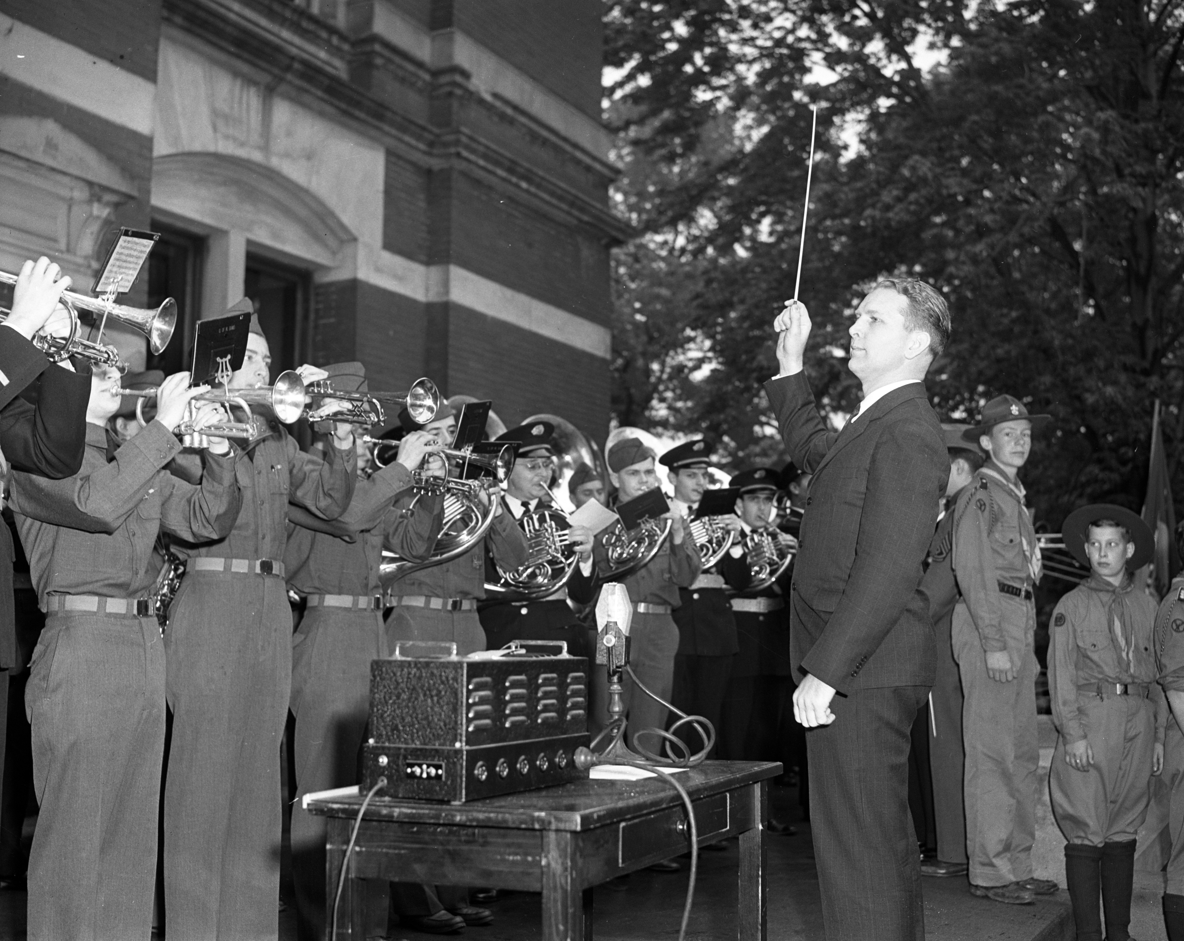 Russell S. Howland conducts the University ROTC and marching bands as part of the send-off for draftees at Courthouse Square, May 13, 1942 image