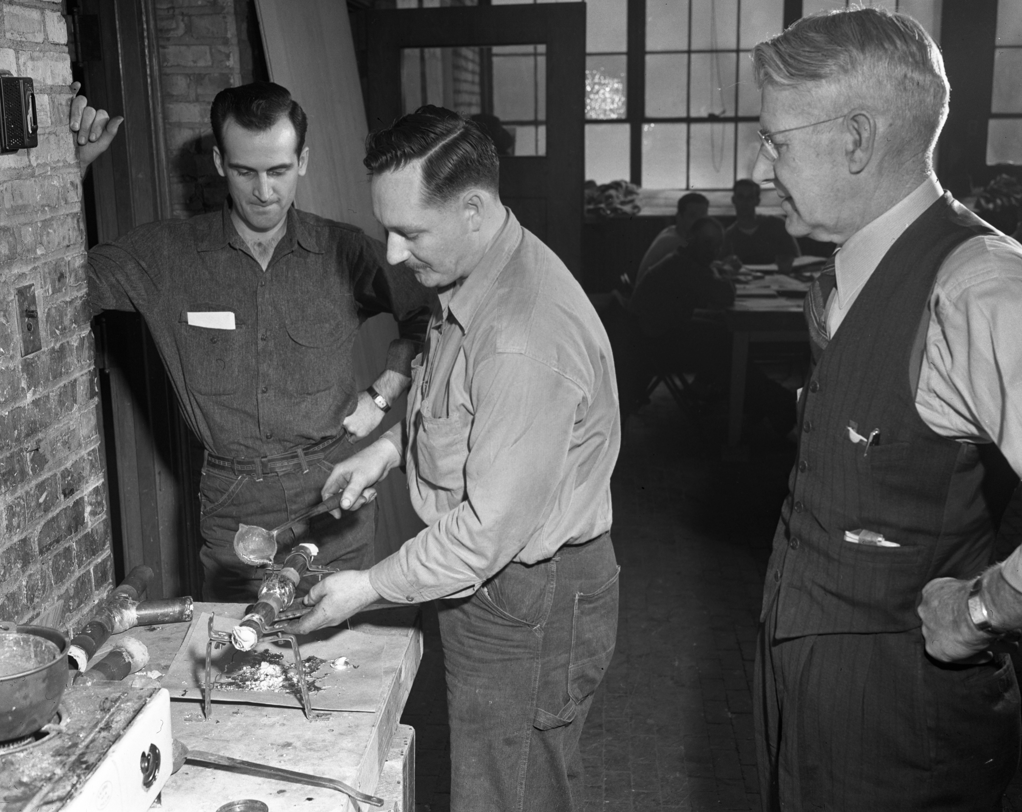Veterans take a class in plumbing at Angell School, March 1948 image