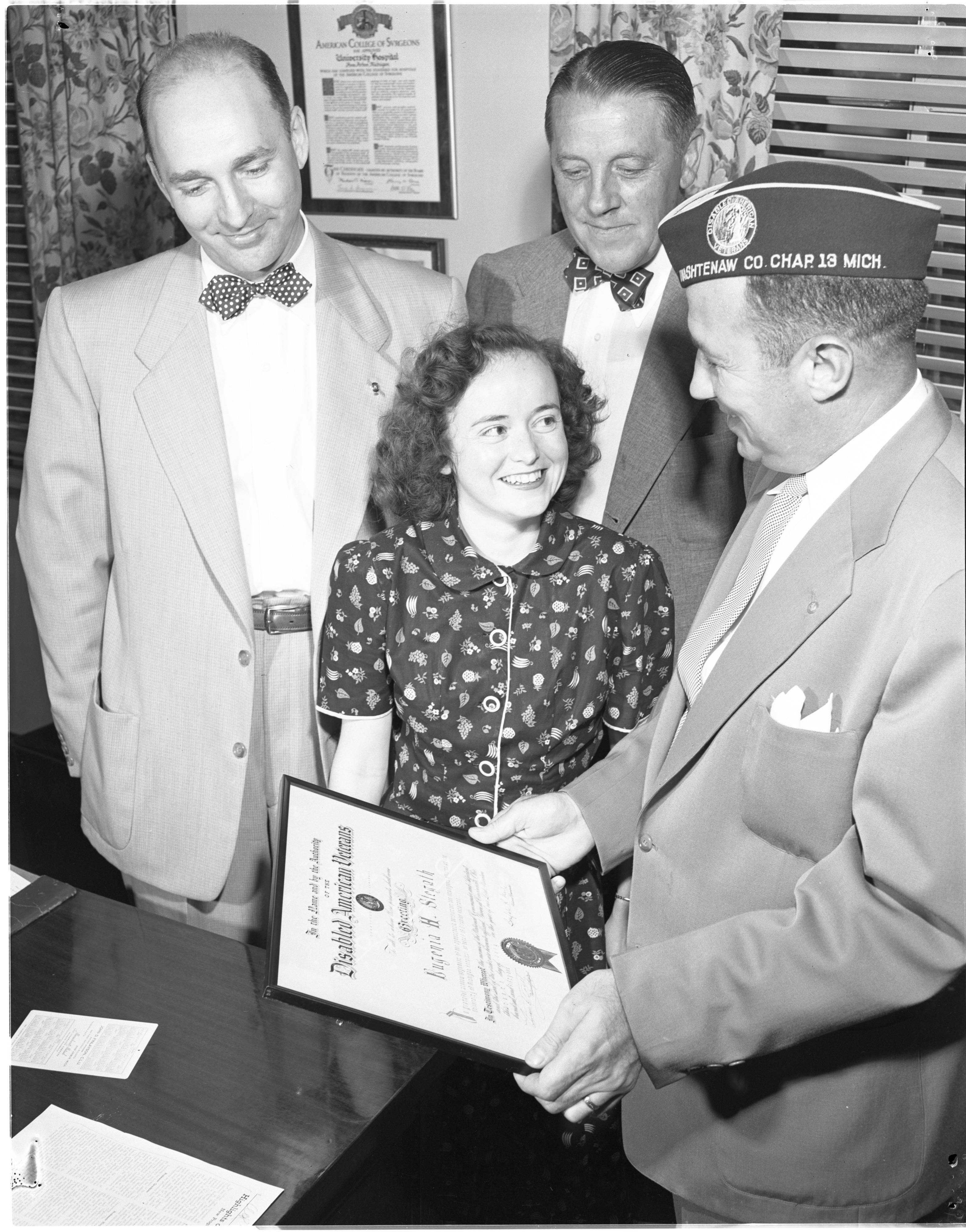 Eugenia Stegath Receives A Certificate Of Merit For Her Work With Disabled Veterans At University Hospital, July 1951 image