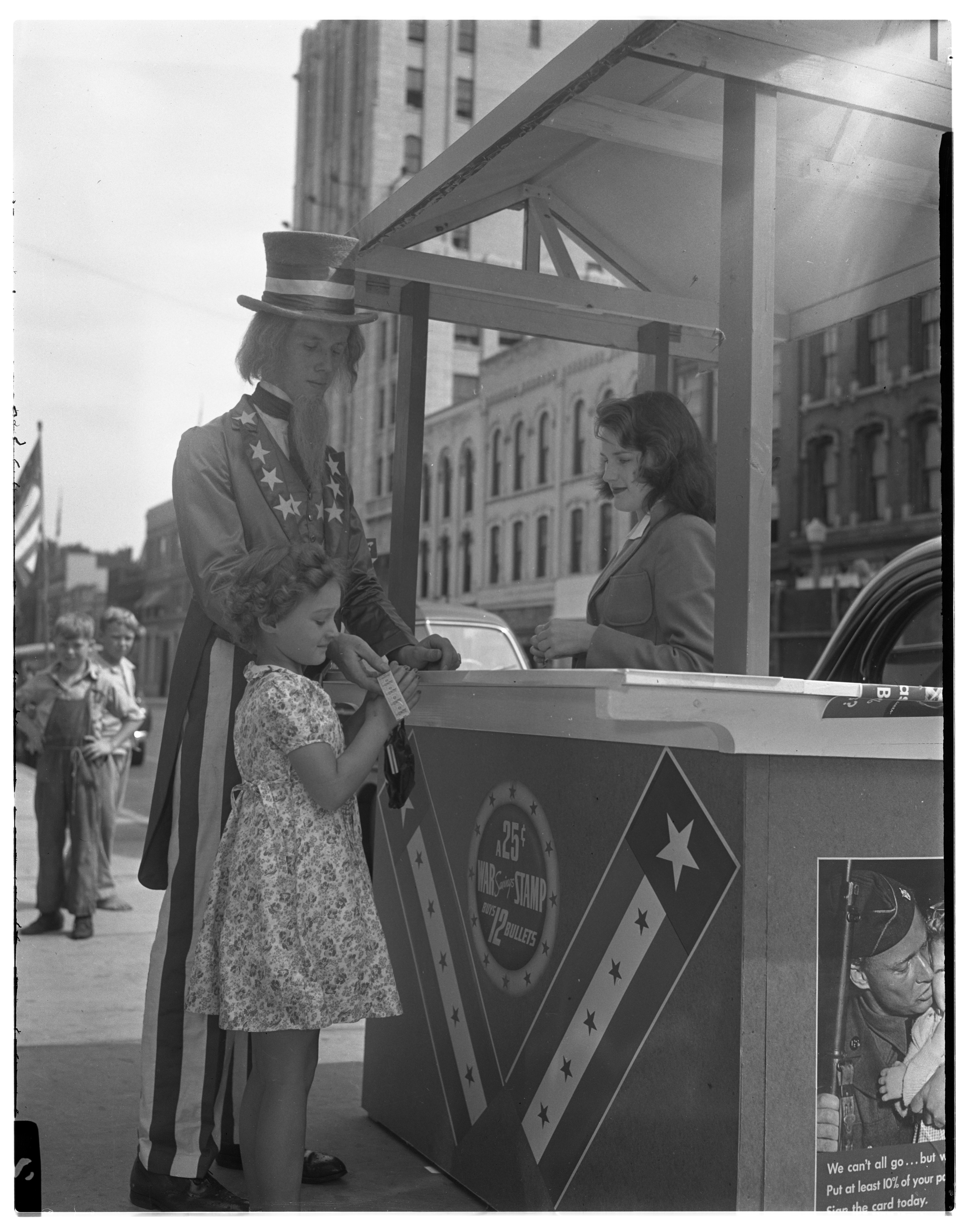 """Uncle Sam"" and Cunningham Drugs employee aid bond sale, July 1942 image"