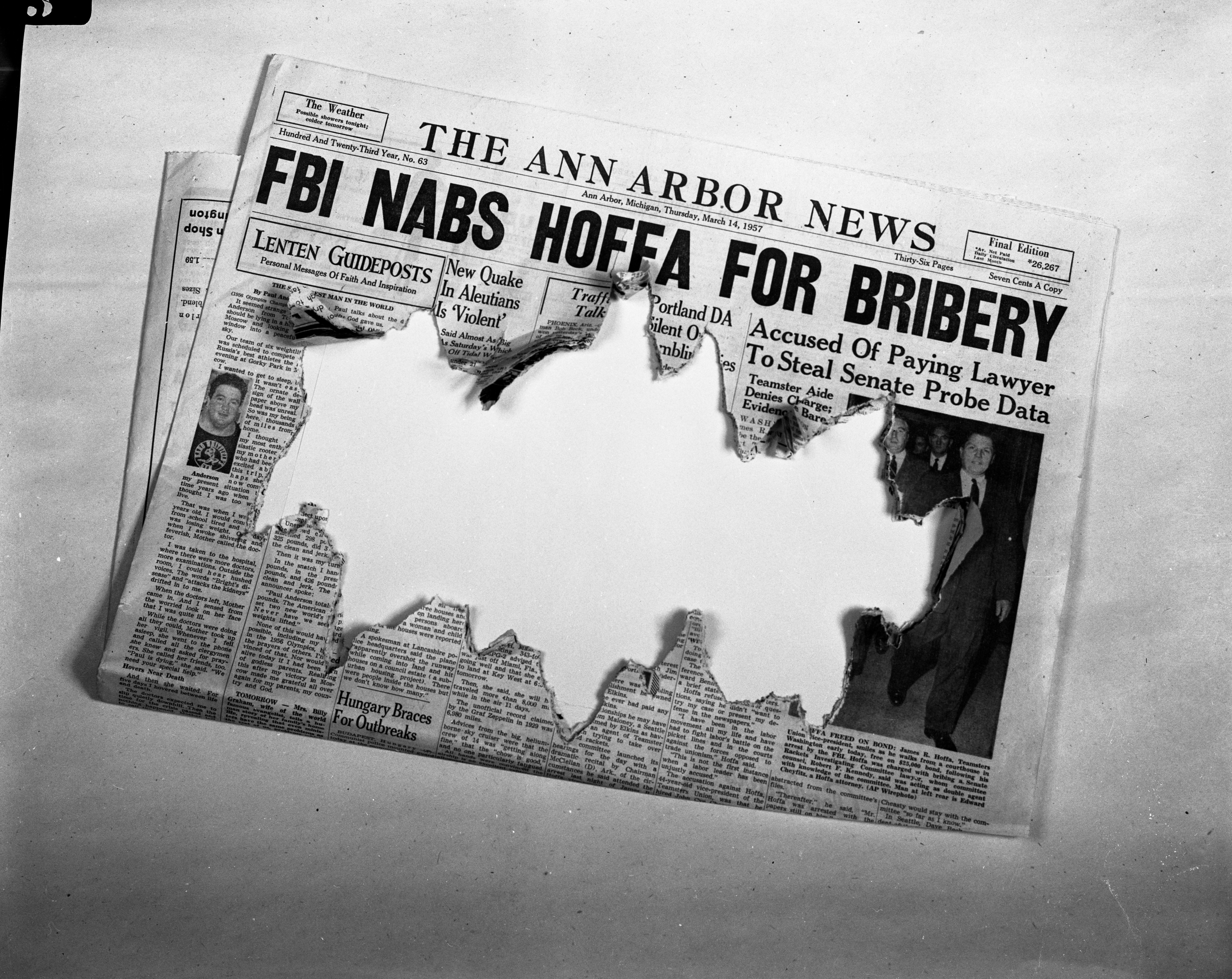 Destroyed front page of March 14, 1957 issue of Ann Arbor News, March 1957 image