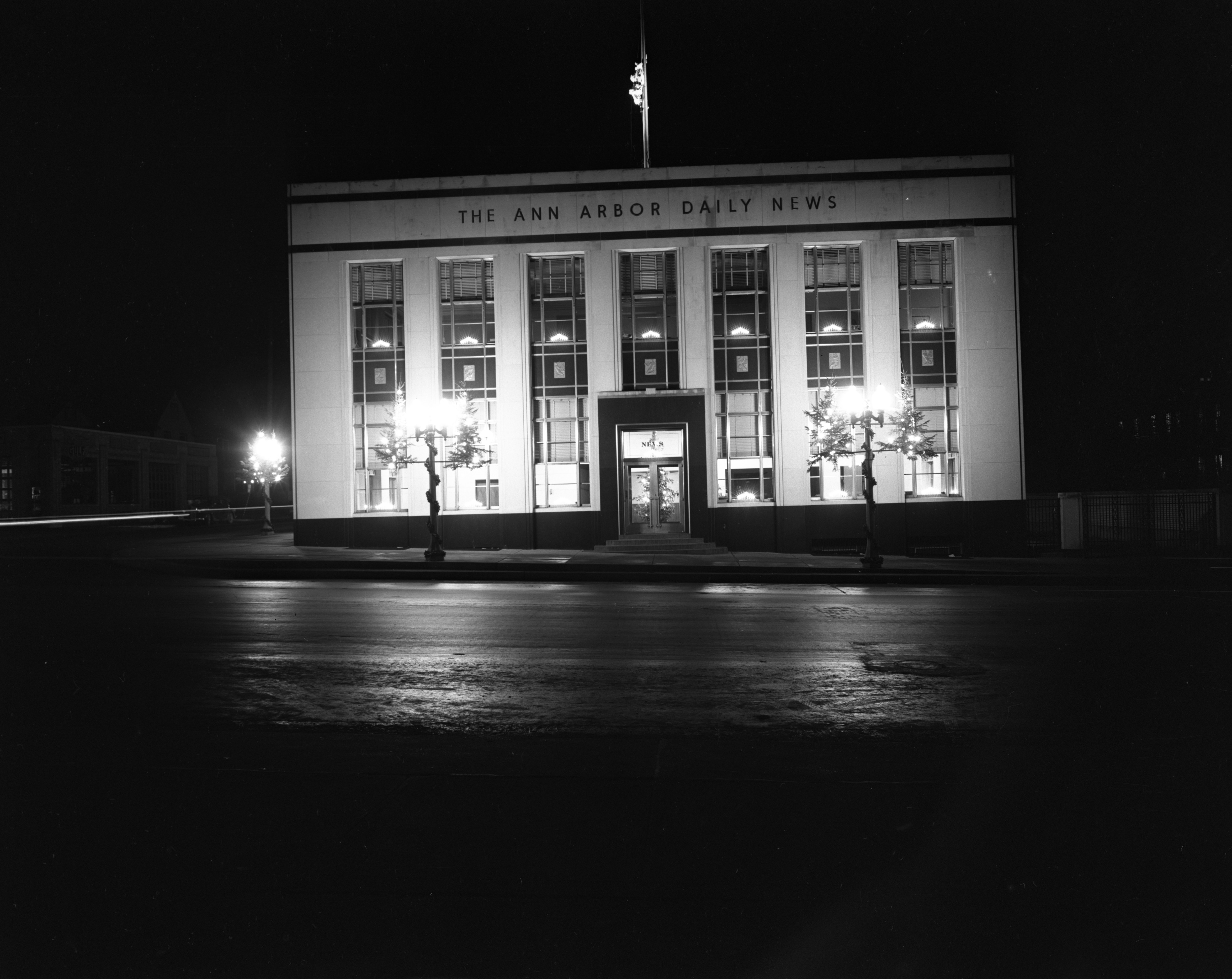 Christmas lights on the Ann Arbor Daily News Building at night, December 1939 image