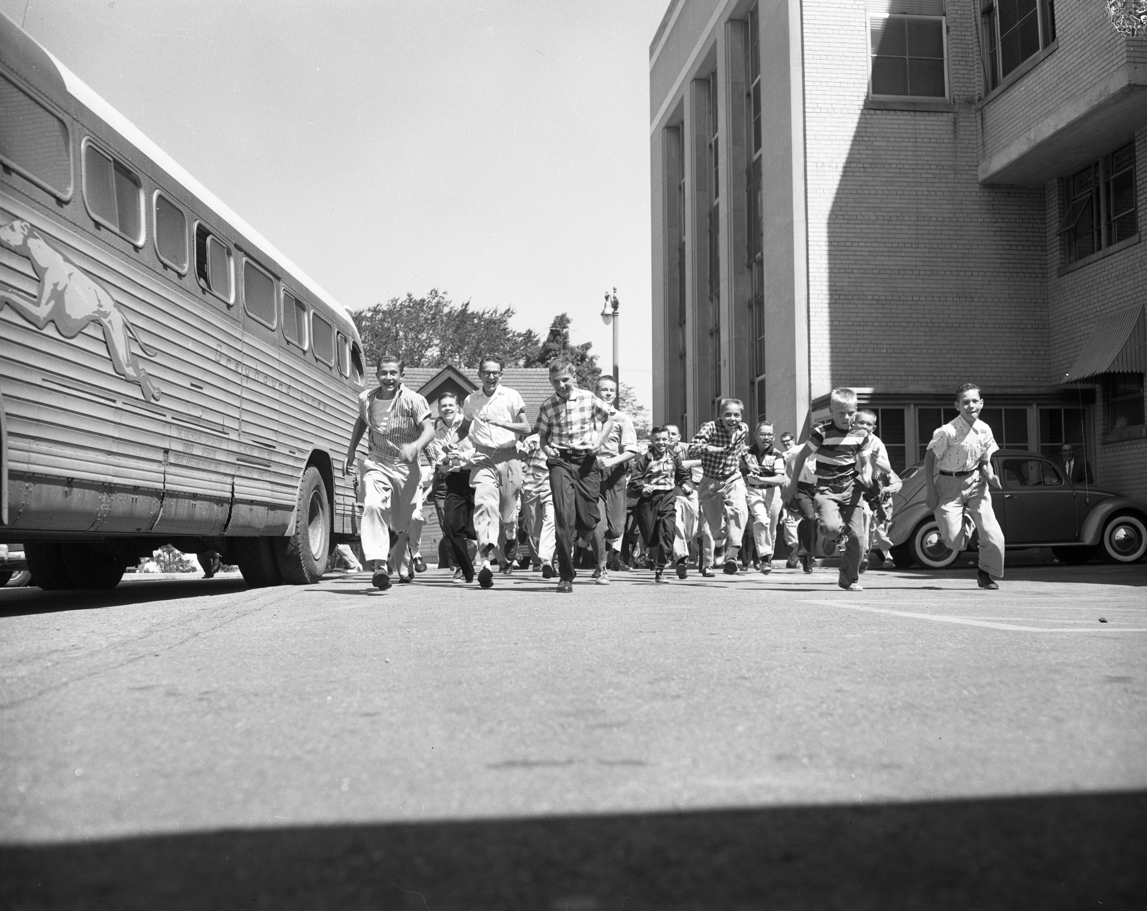 Ann Arbor Newsboys get ready to attend baseball game in Detroit, August 1957 image