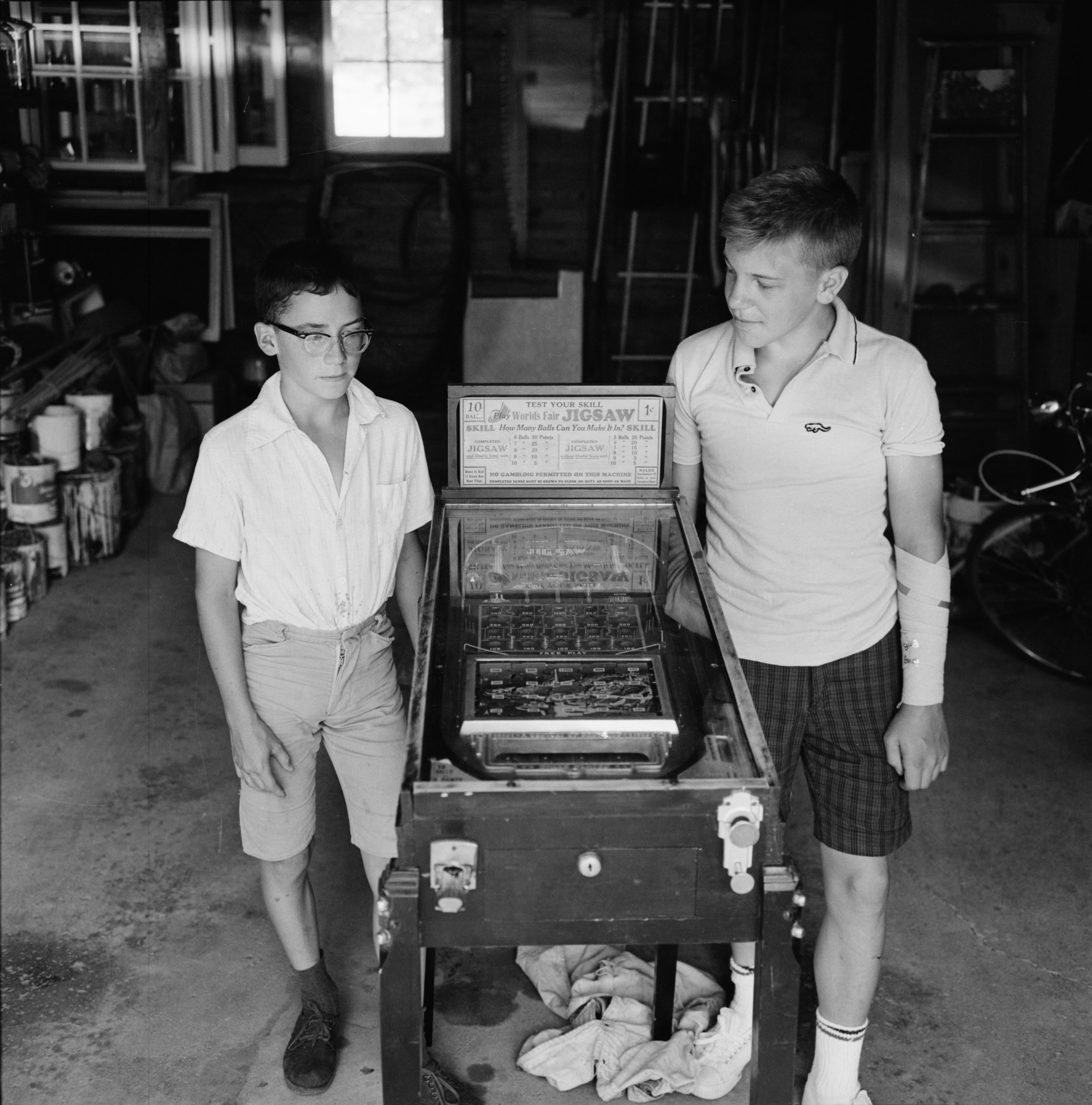 Ann Arbor News boy gets antique pinball machine from 1933 World's Fair, June 1964 image