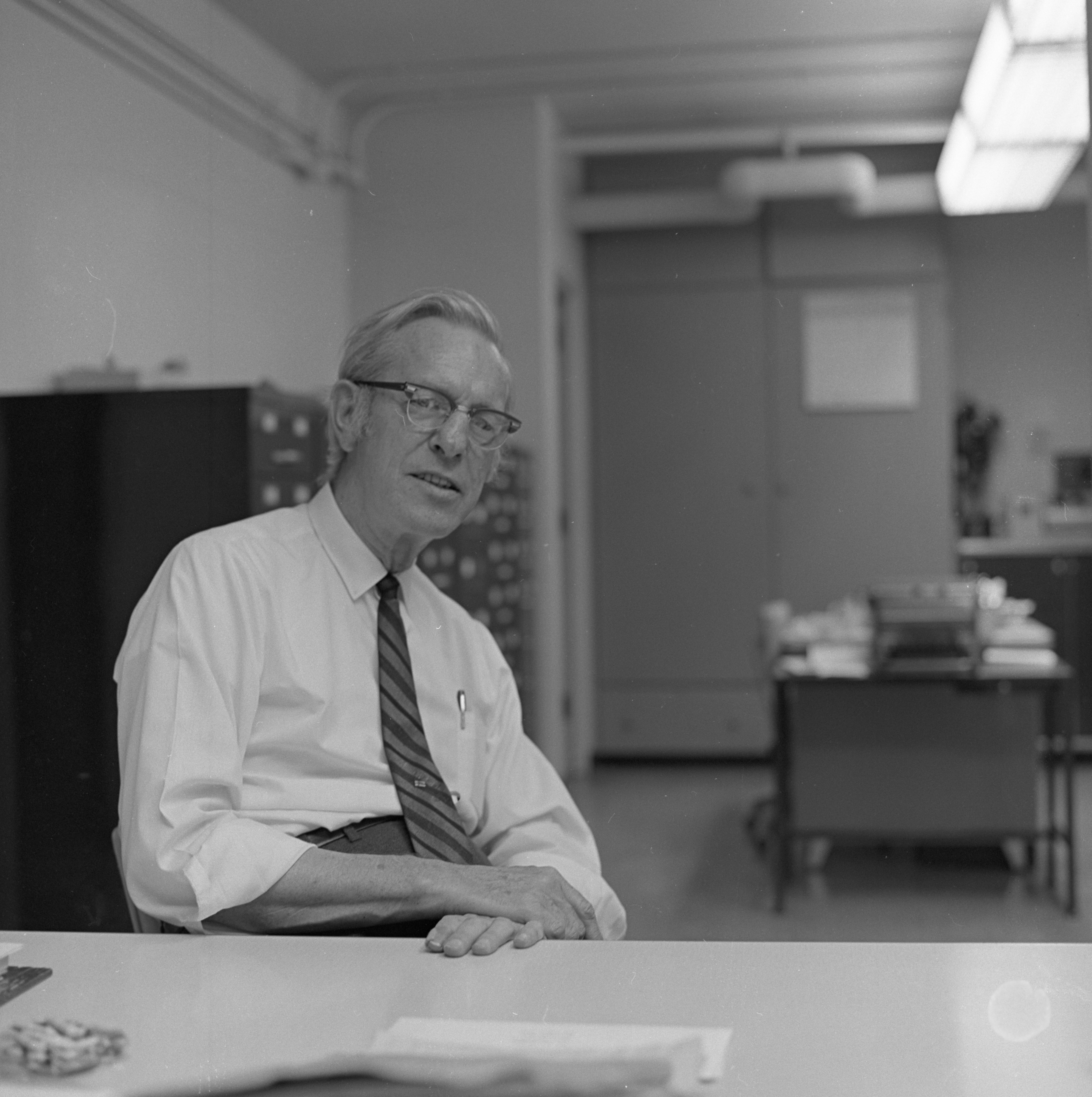 Ann Arbor News Photographer Eck Stanger In His Office, July 1969 image