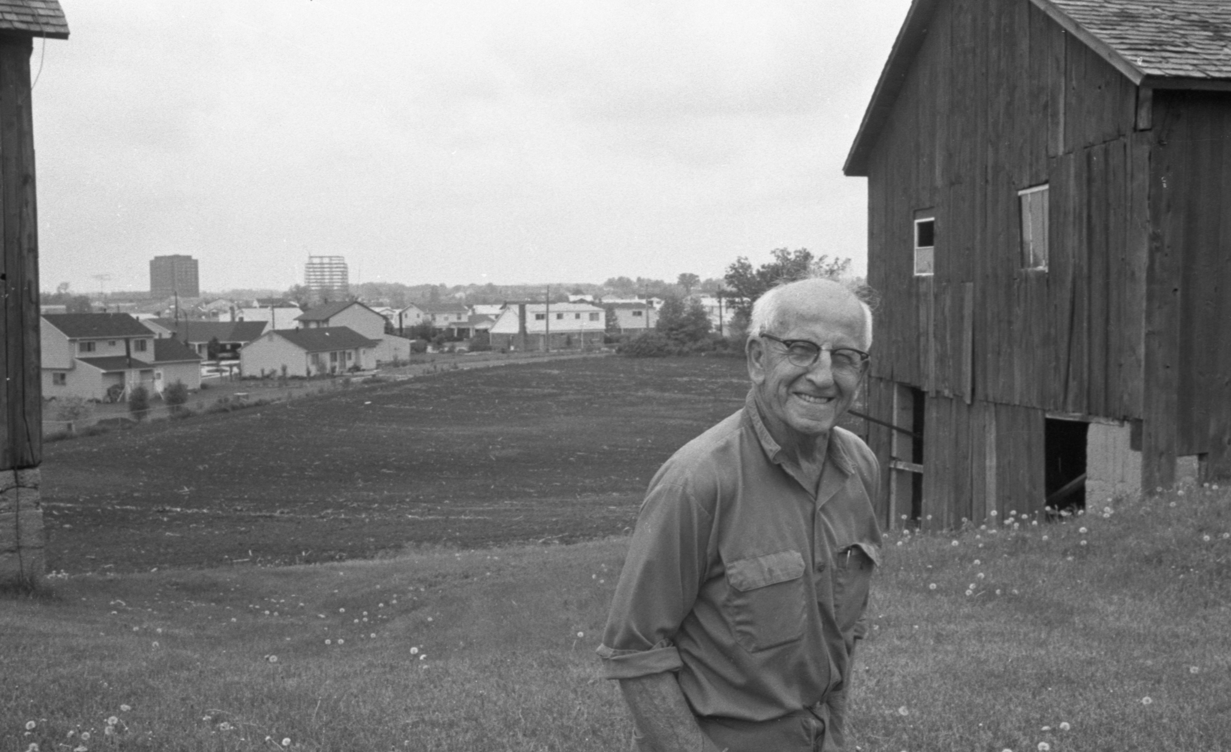Donald Ticknor On His Farm Bordered By Georgetown Subdivision, June 1974 image
