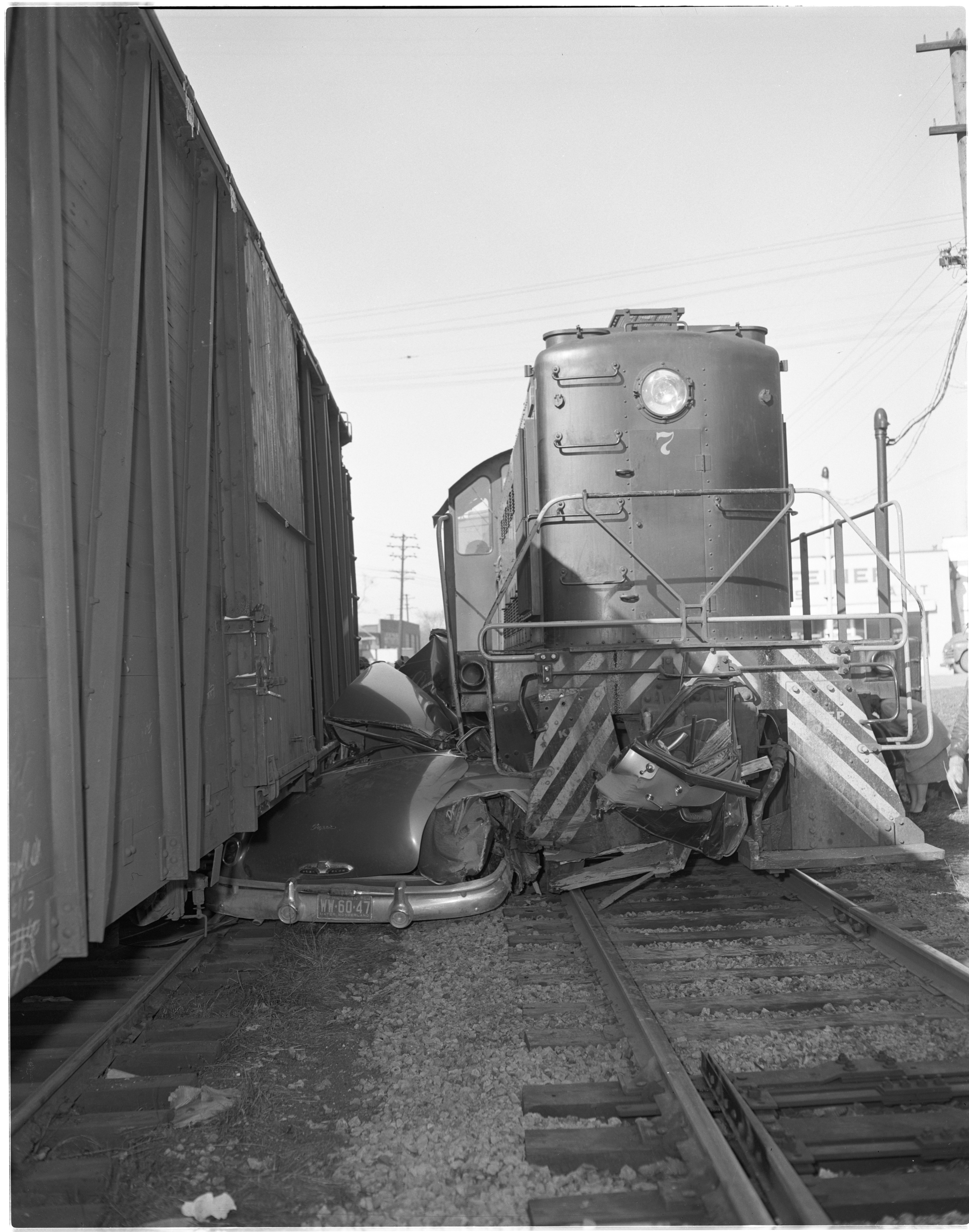 Accident Scene of Albert Trinkle's Car Smashed Between Two Trains, January 1954 image