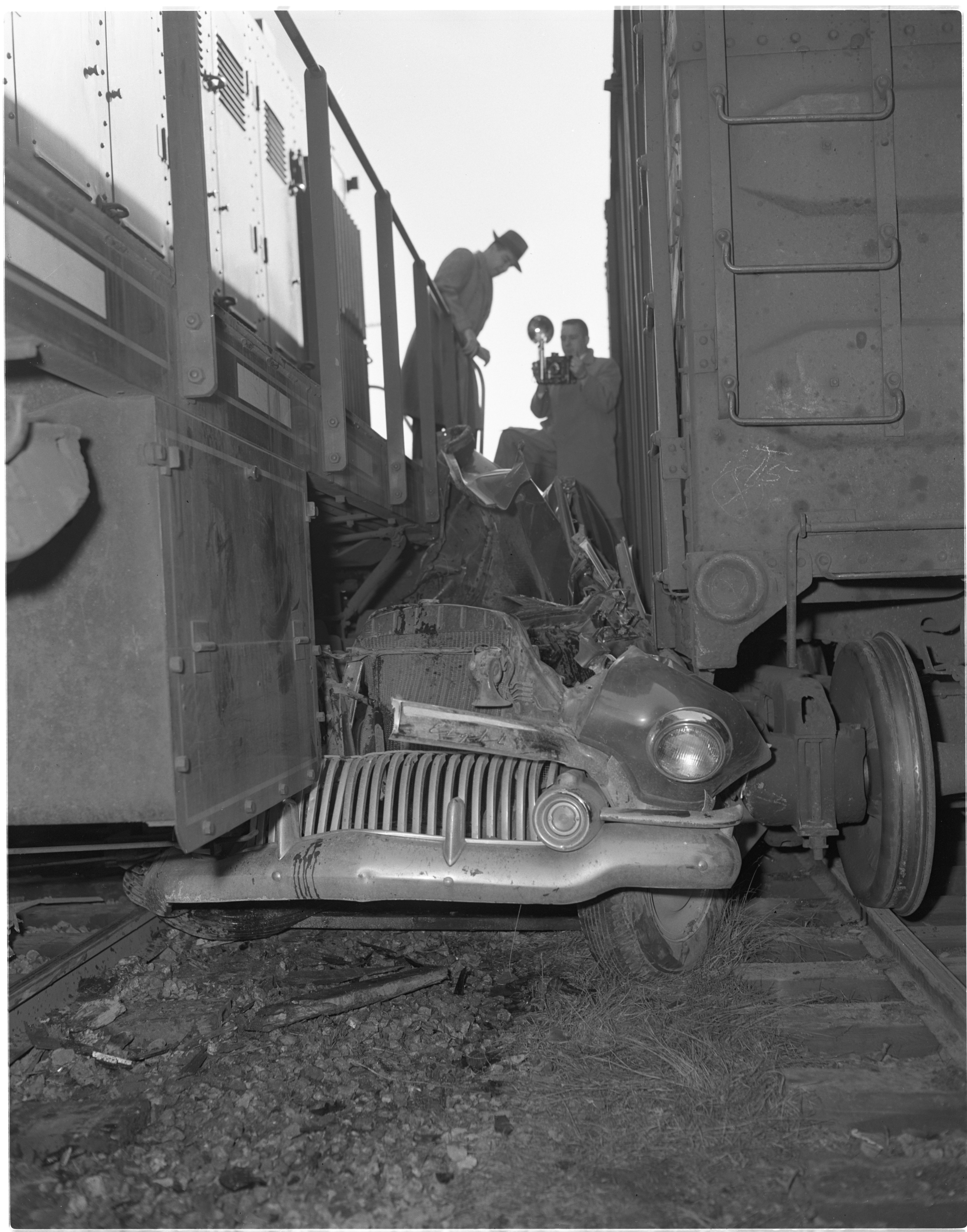 Investigators Examine Accident Scene of Albert Trinkle's Car Smashed Between Two Trains, January 1954 image