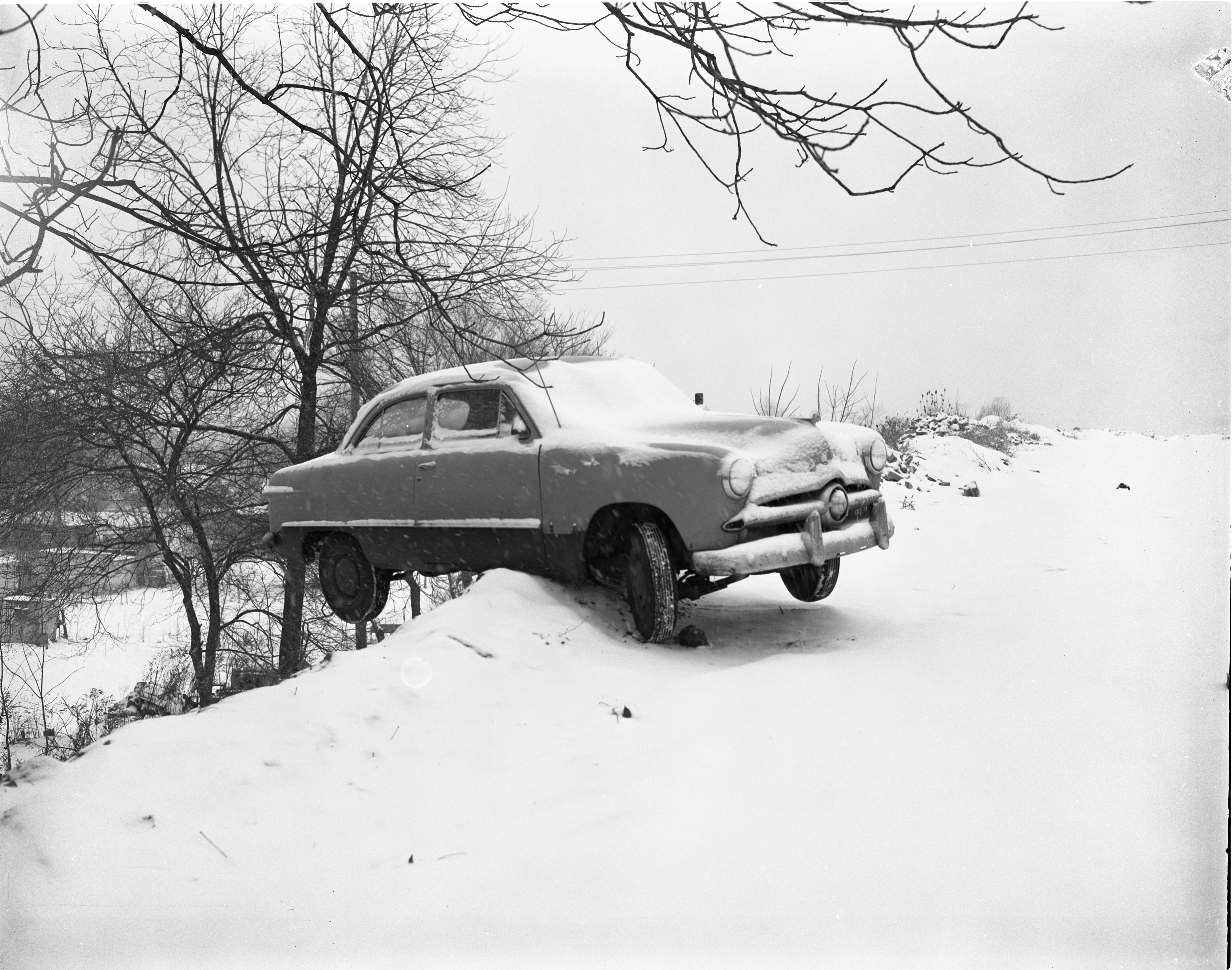 Car Hangs Off Hill Near The American Legion Home, January 1956 image